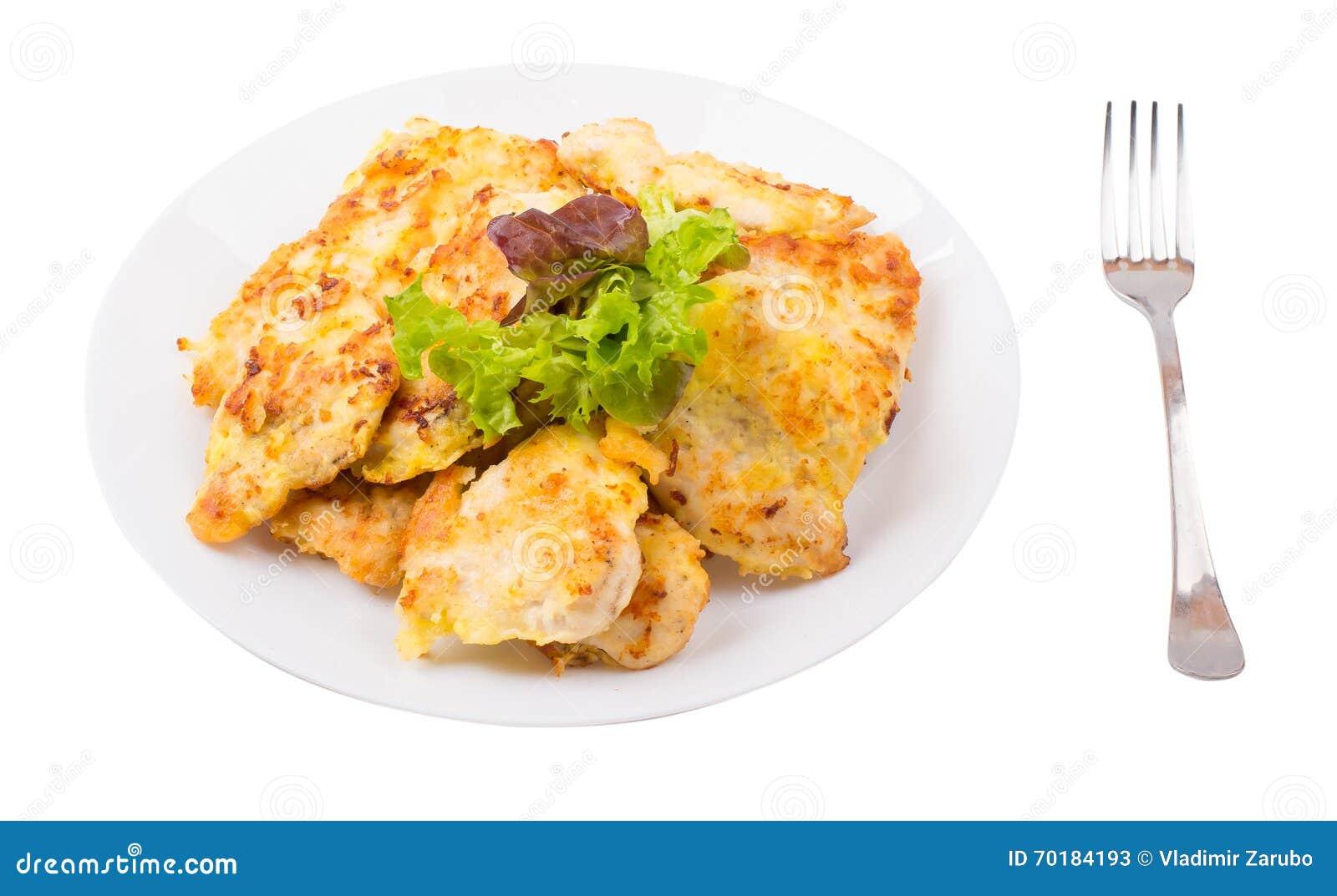 Kotletter med höna i en platta på a