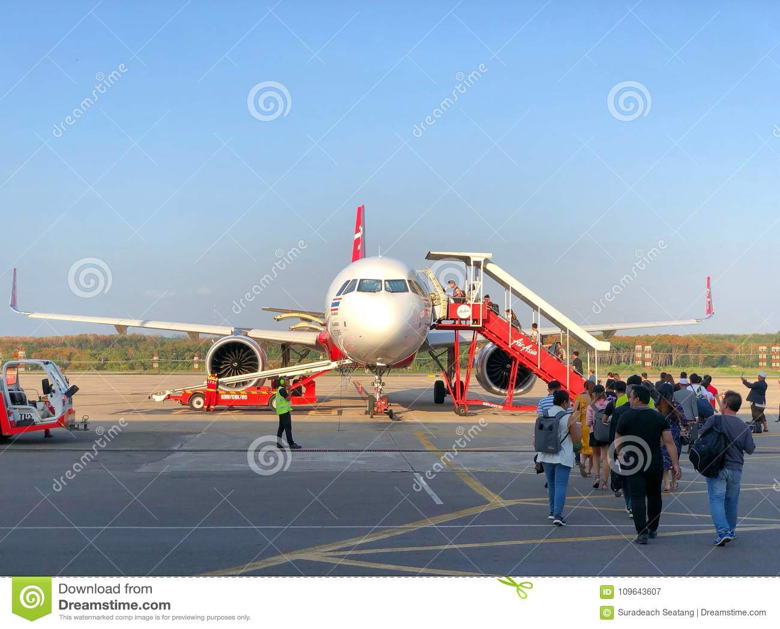 Many passengers walking to the airplane flight Krabi to Bangkok