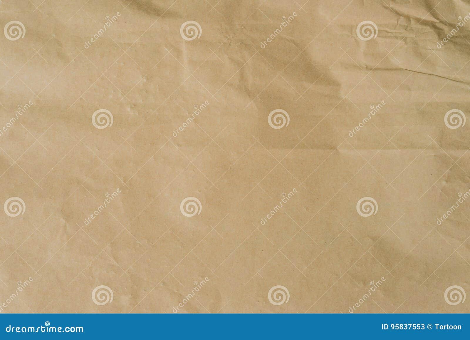 Kraft brunt papper och skrynklig bakgrundstextur med utrymme