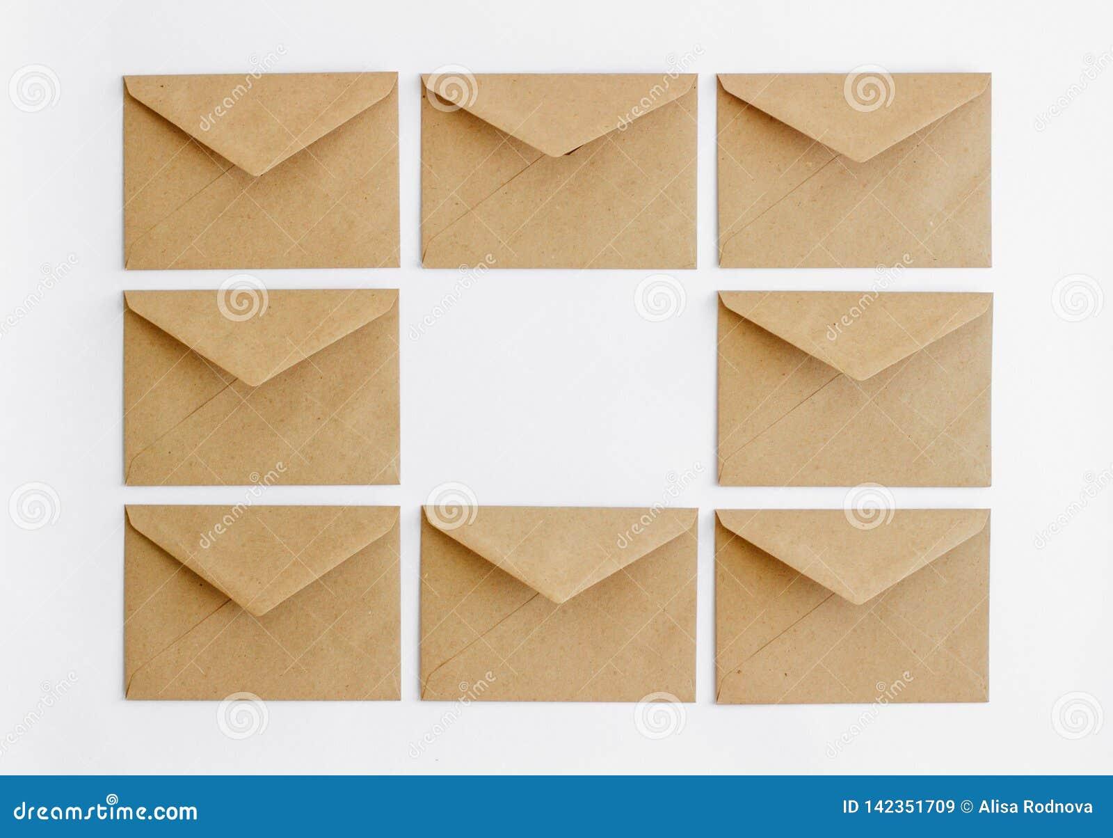 Kraft postal envelopes on a white background.