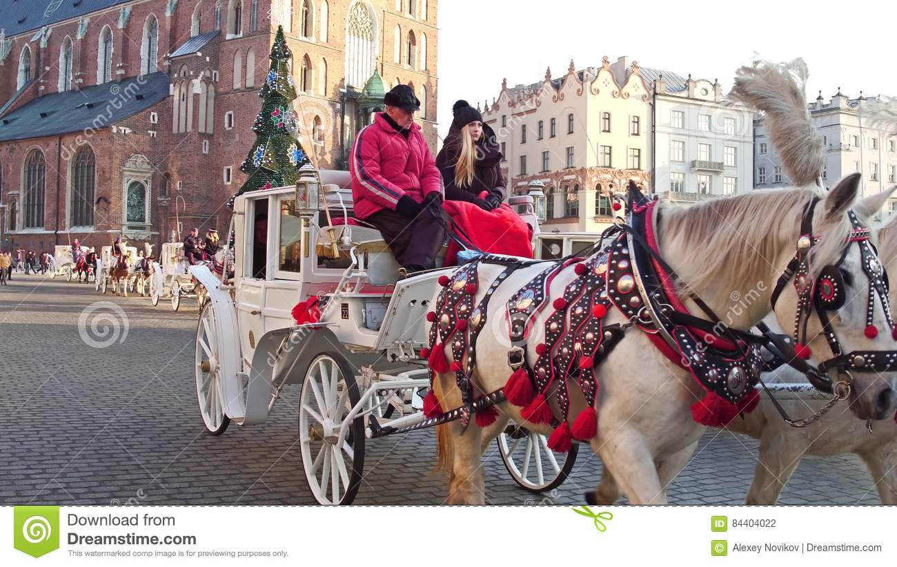 Krakow Poland January 14 2017 Steadicam Shot Of Retro Horse Drawn Carriage And Christmas Decorated Touristic Street Stock Footage Video Of Public Retro 84404022
