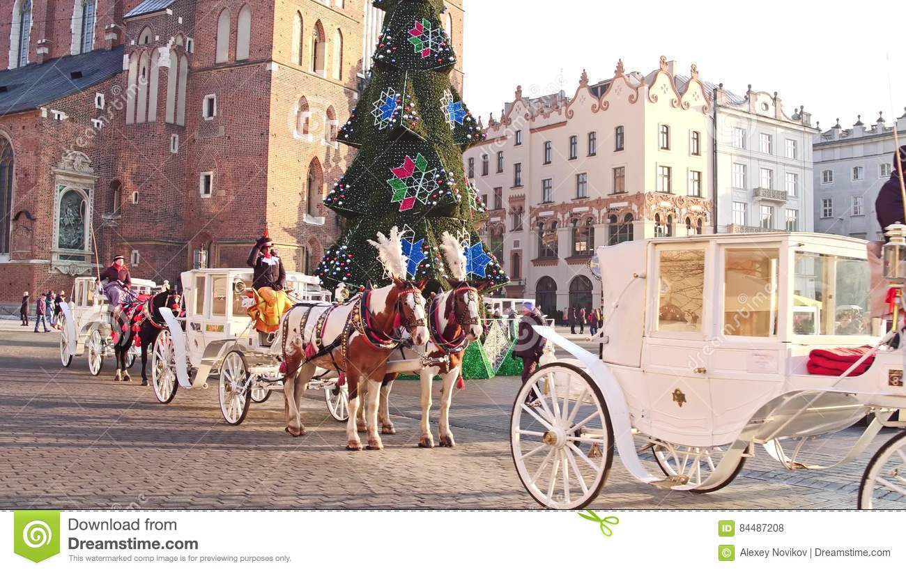 Krakow Poland January 14 2017 Steadicam Shot Of Retro Horse Drawn Carriages And Christmas Decorated Touristic Old Stock Footage Video Of Cobblestone Pedestrian 84487208