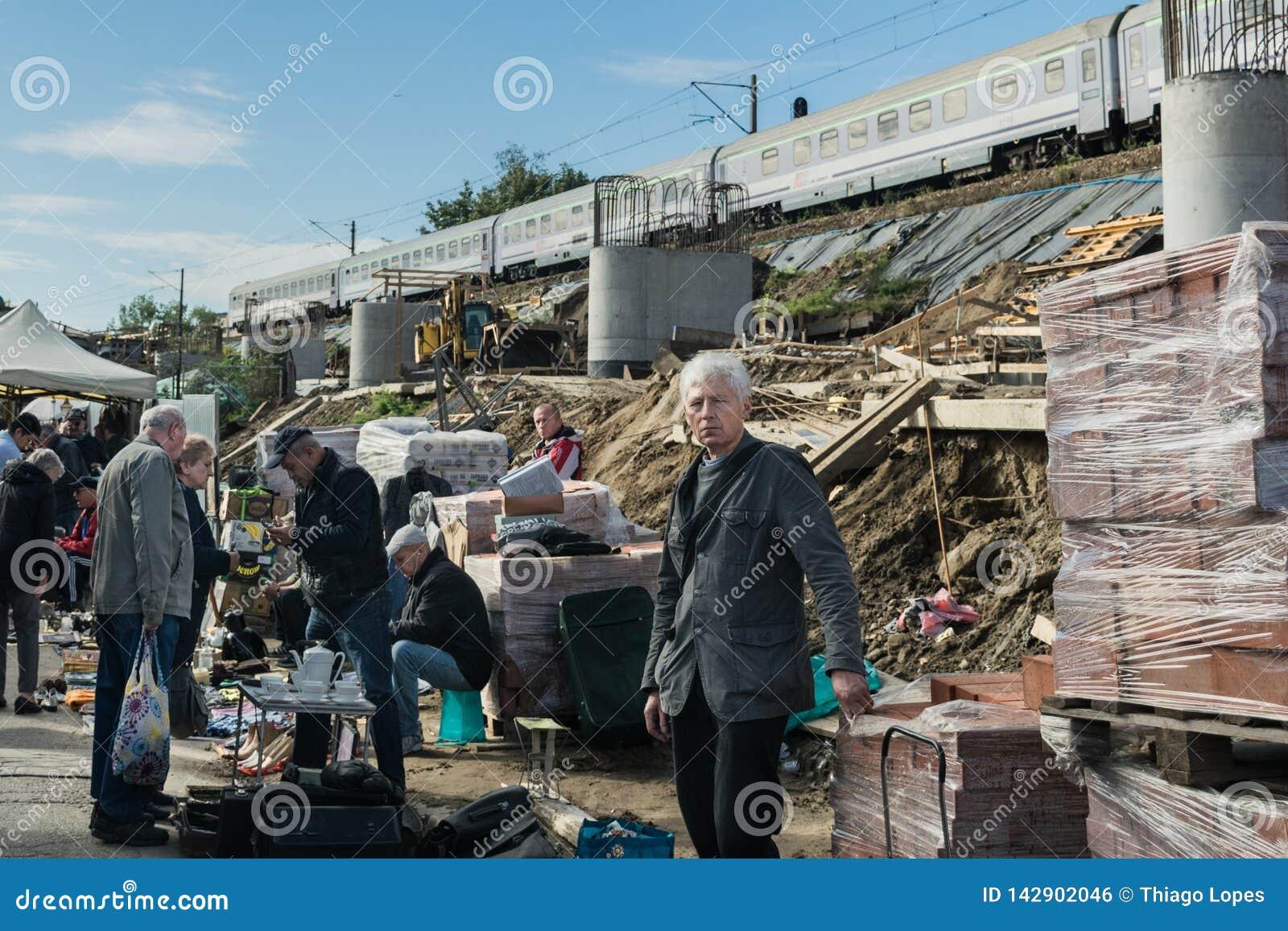 Krakow, Poland - September 21, 2019: Sellers negotiate their goods at the street flea market near the train line in
