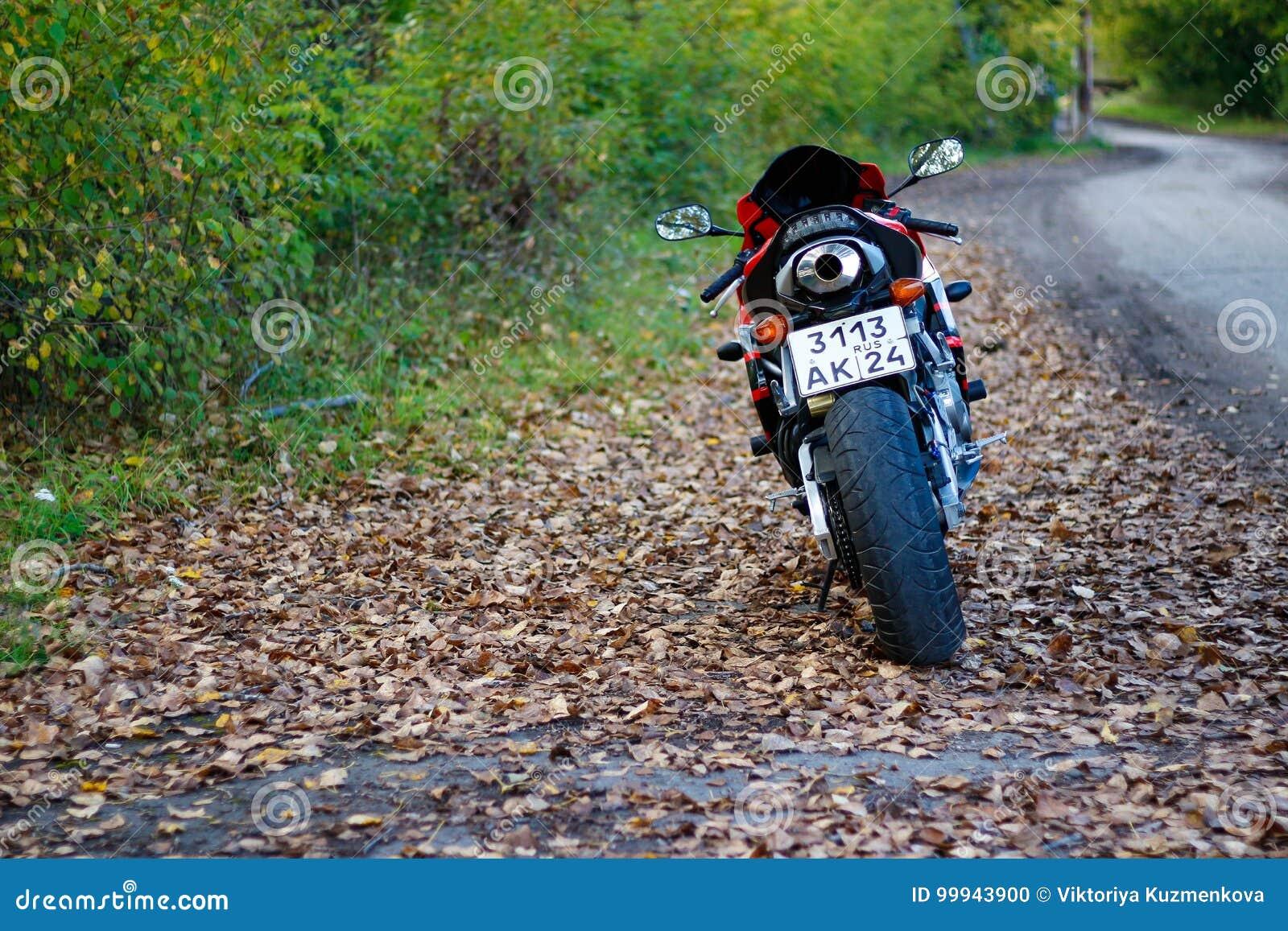 KRASNOYARSK, RUSSIA - SEPTEMBER 1, 2017: Red and black sportbike Honda CBR 600 RR 2005 PC37. Autumn yellow leaves