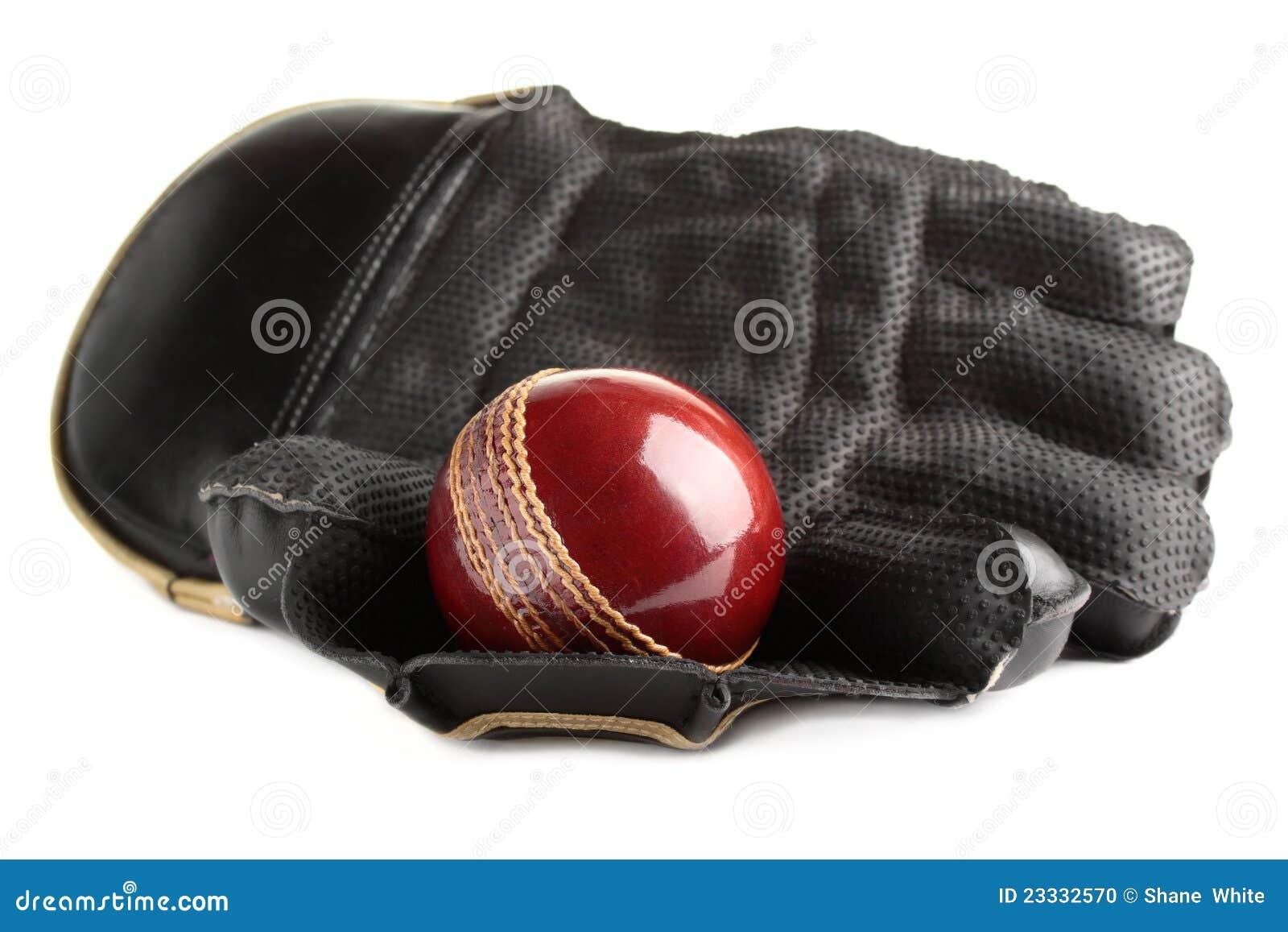 Kricketkugel und -handschuh.