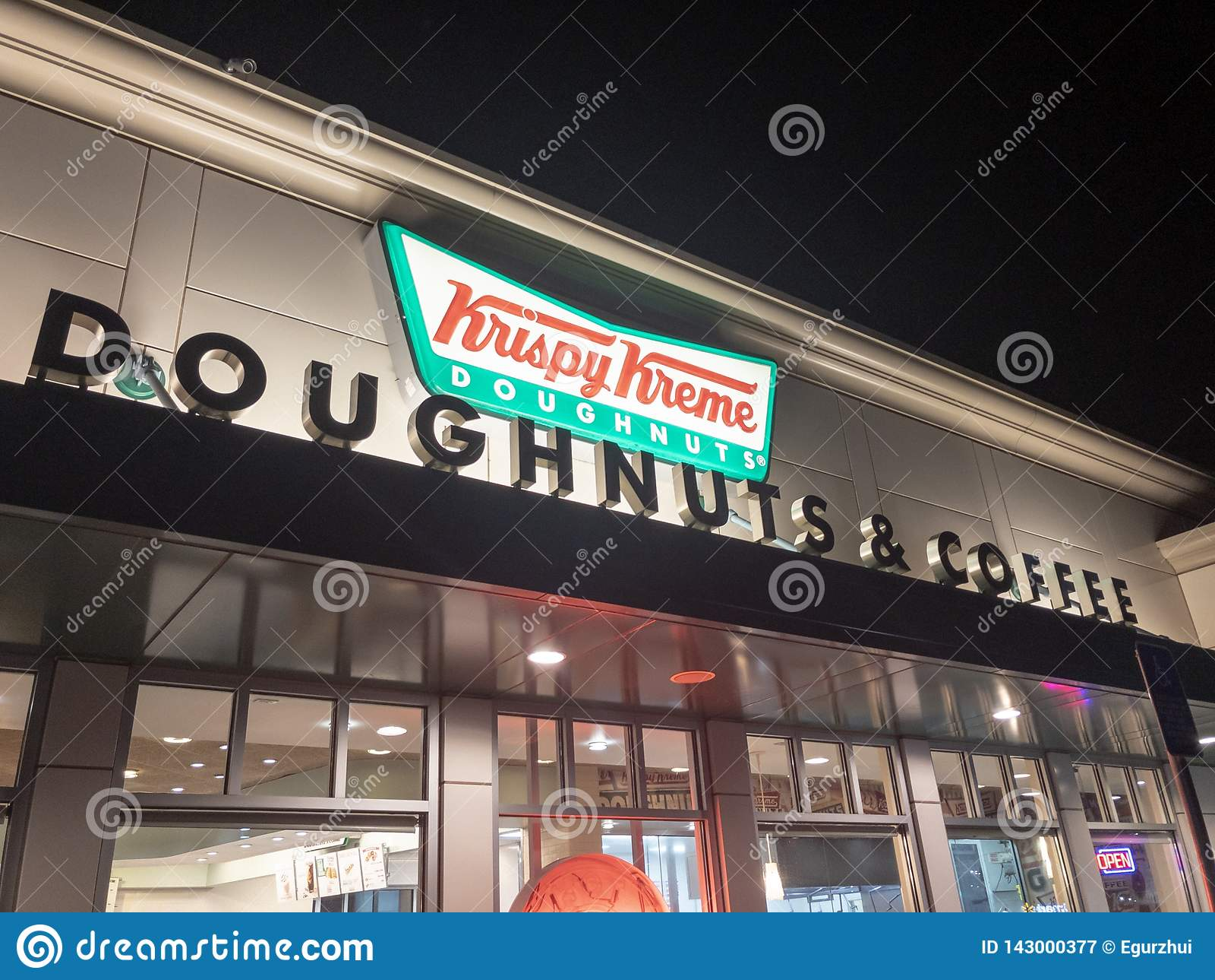 Krispy Kreme Doughnuts storefront at night