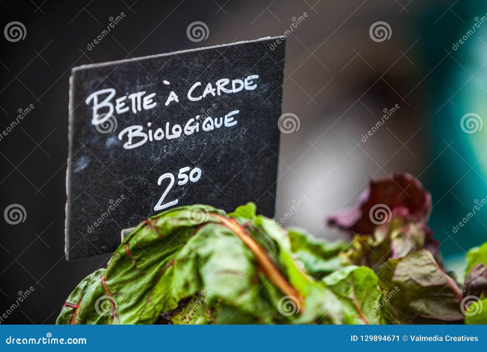 Kritatecken som säljer den organiska schweiziska charden under biologiquen för carde för ½ för ¿ för namnbetteï