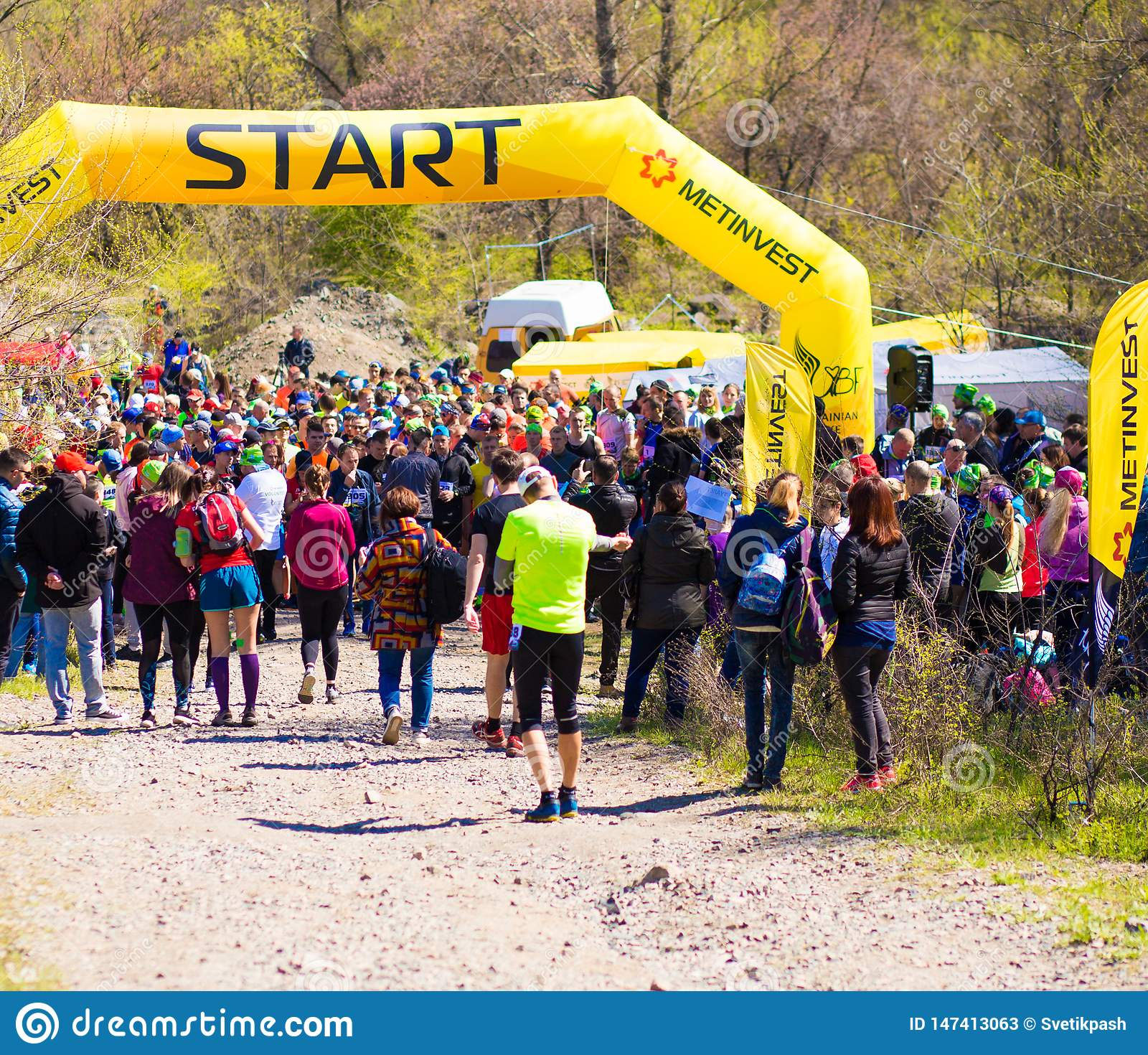 Krivoy Rog, Ukraine - 21 April, 2019: Group of young athletes in start position. Fit young people preparing for Marathon
