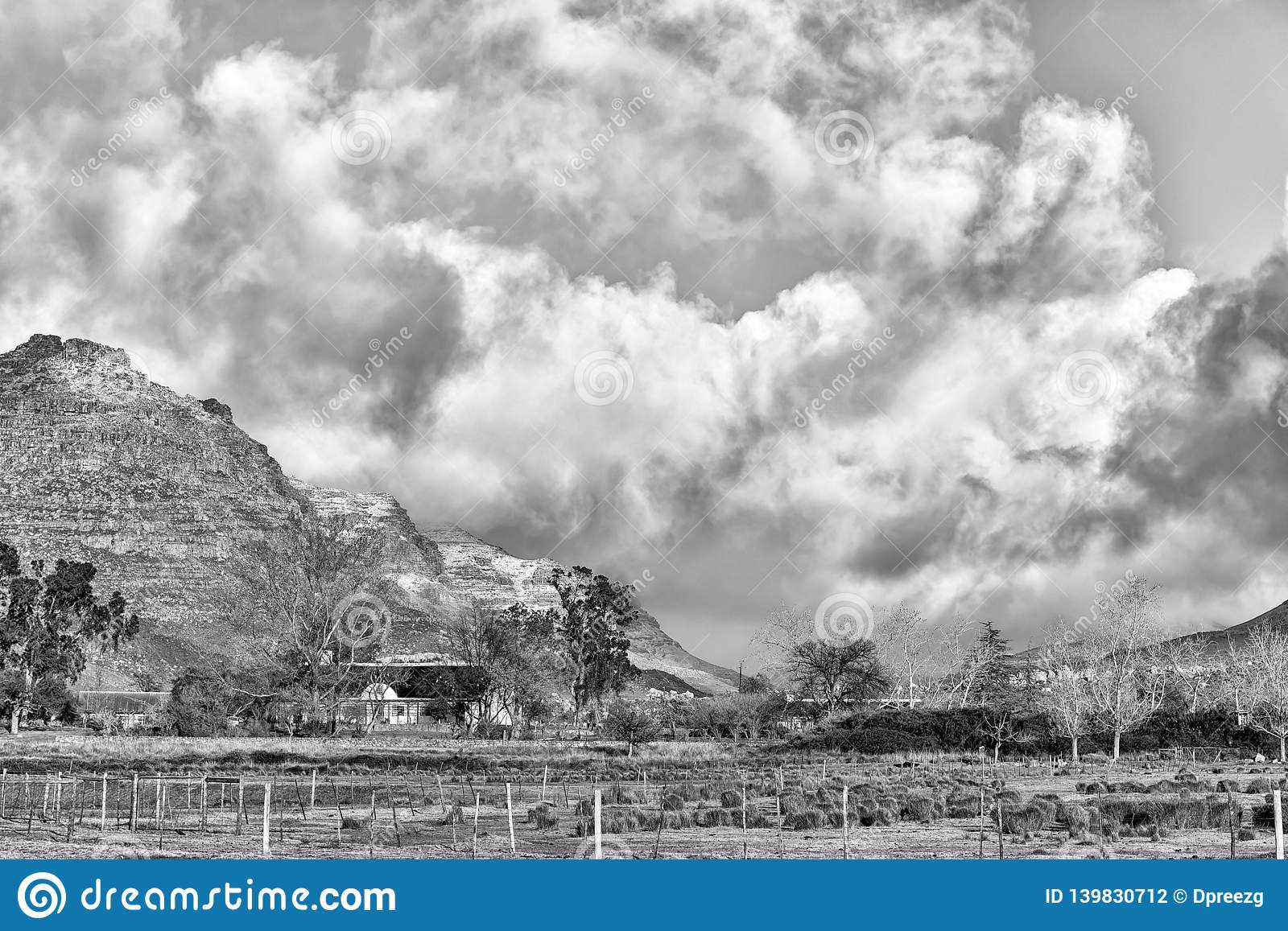 Snow is visible on the mountains at Kromrivier Cederberg. Monochrome