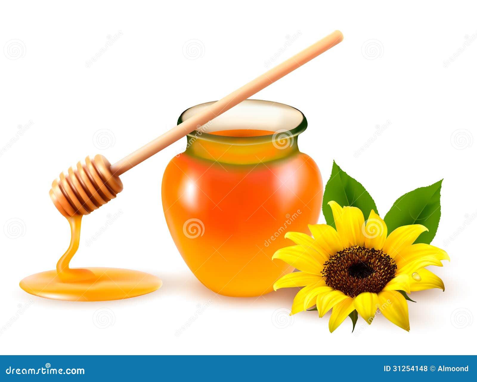 Krus av honung och en oljesticka med den gula blomman.