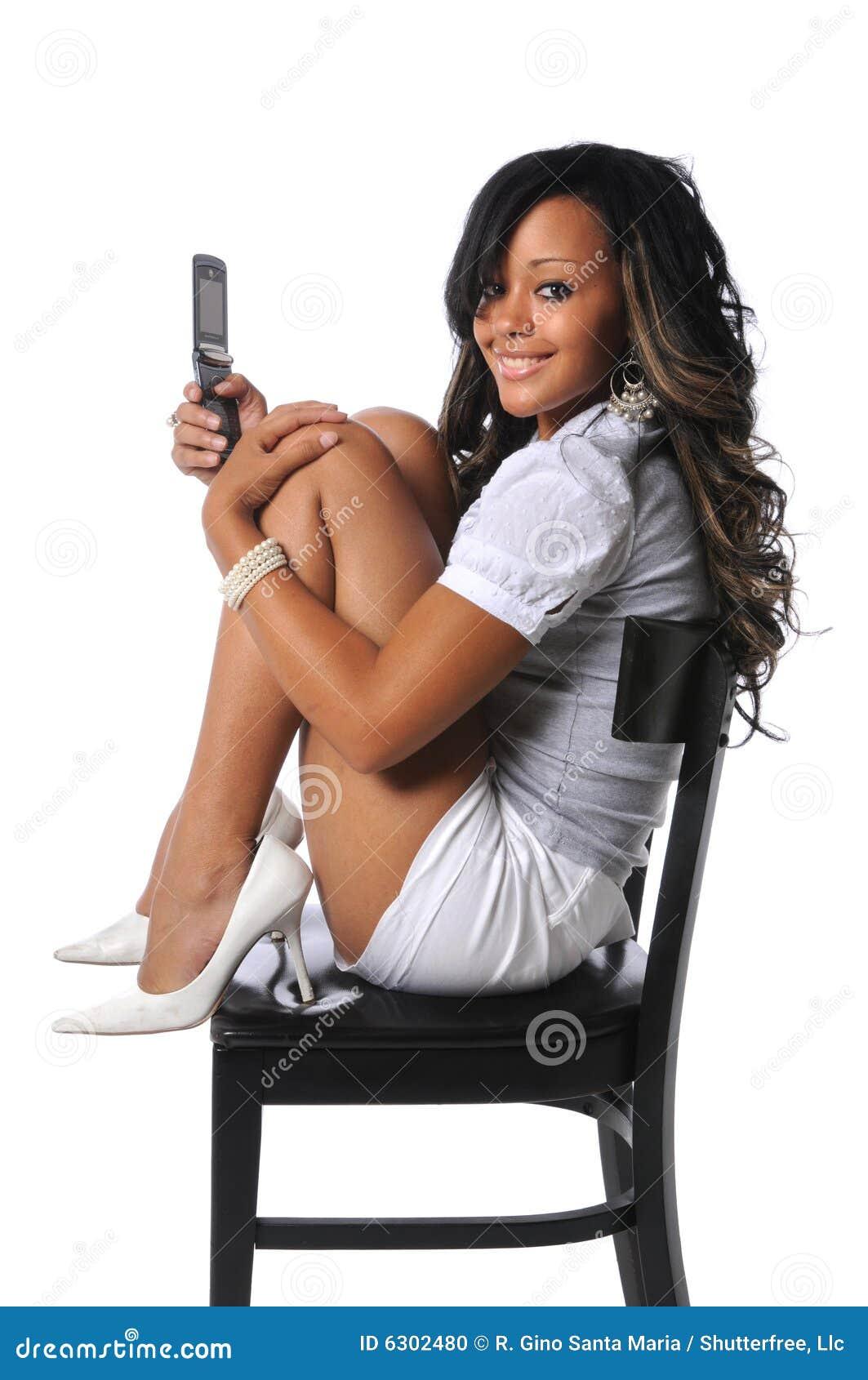 Krzesło komórek telefonu kobiety