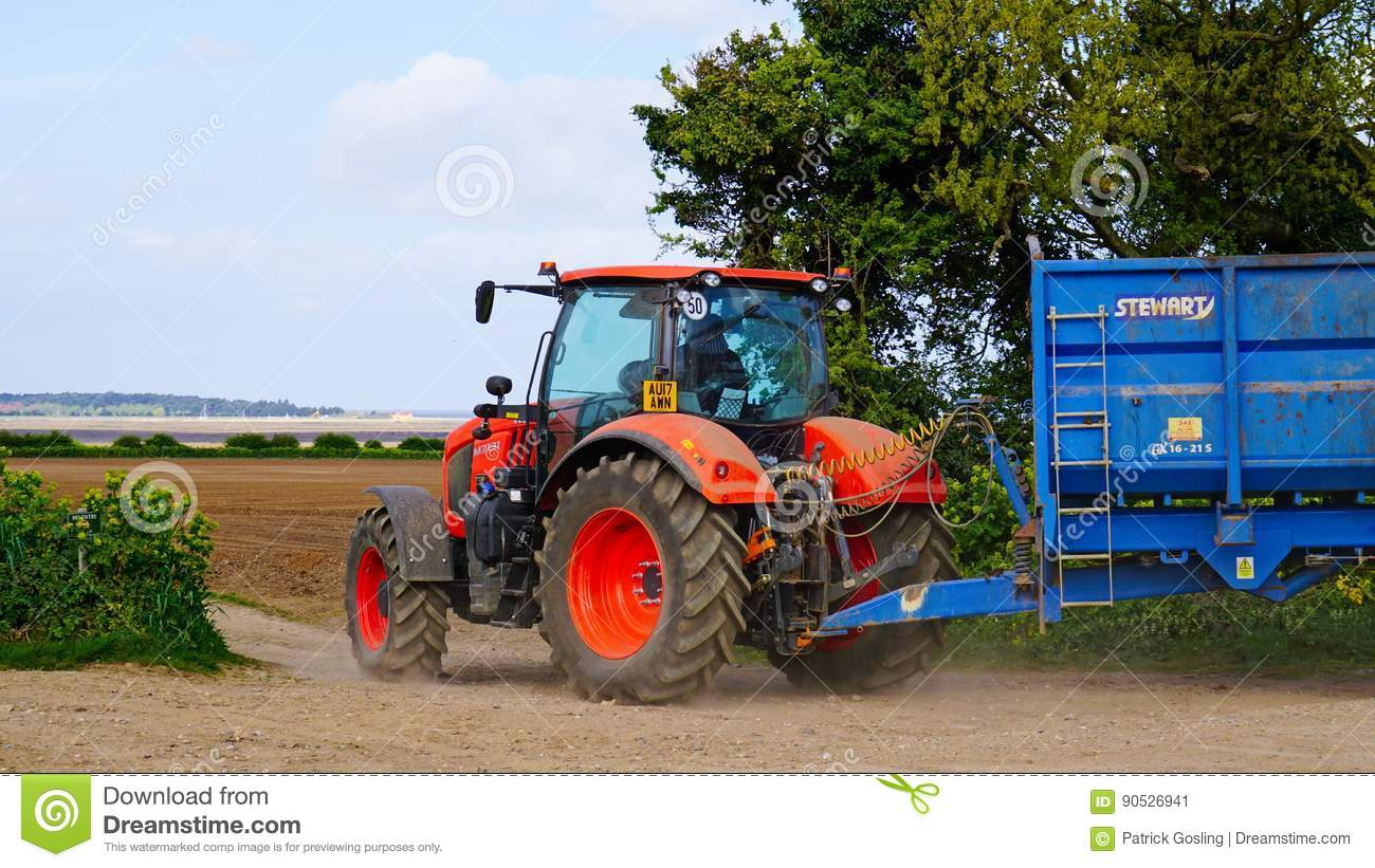 Tractor Pulling Trailer : Kubota m tractor editorial photo image of