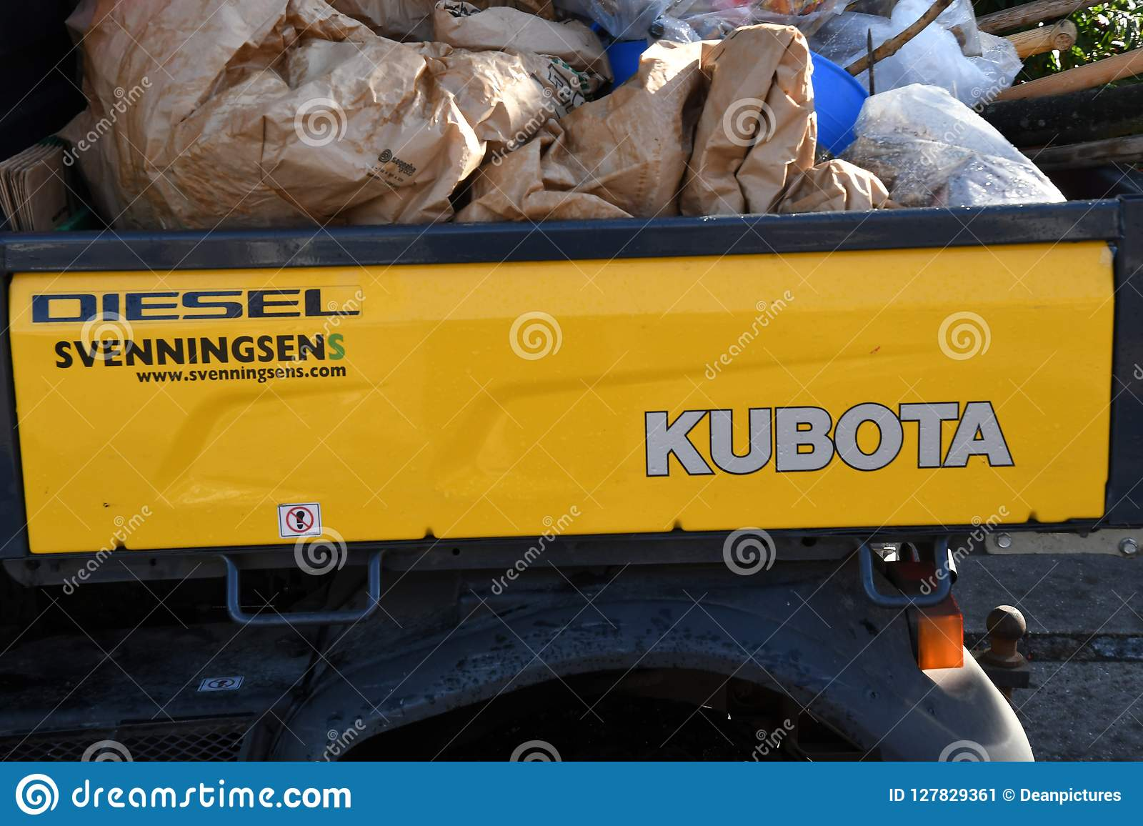 KUBOTA TRACKTOR DRIVES ON DIESE� TRANSPORT WASTE