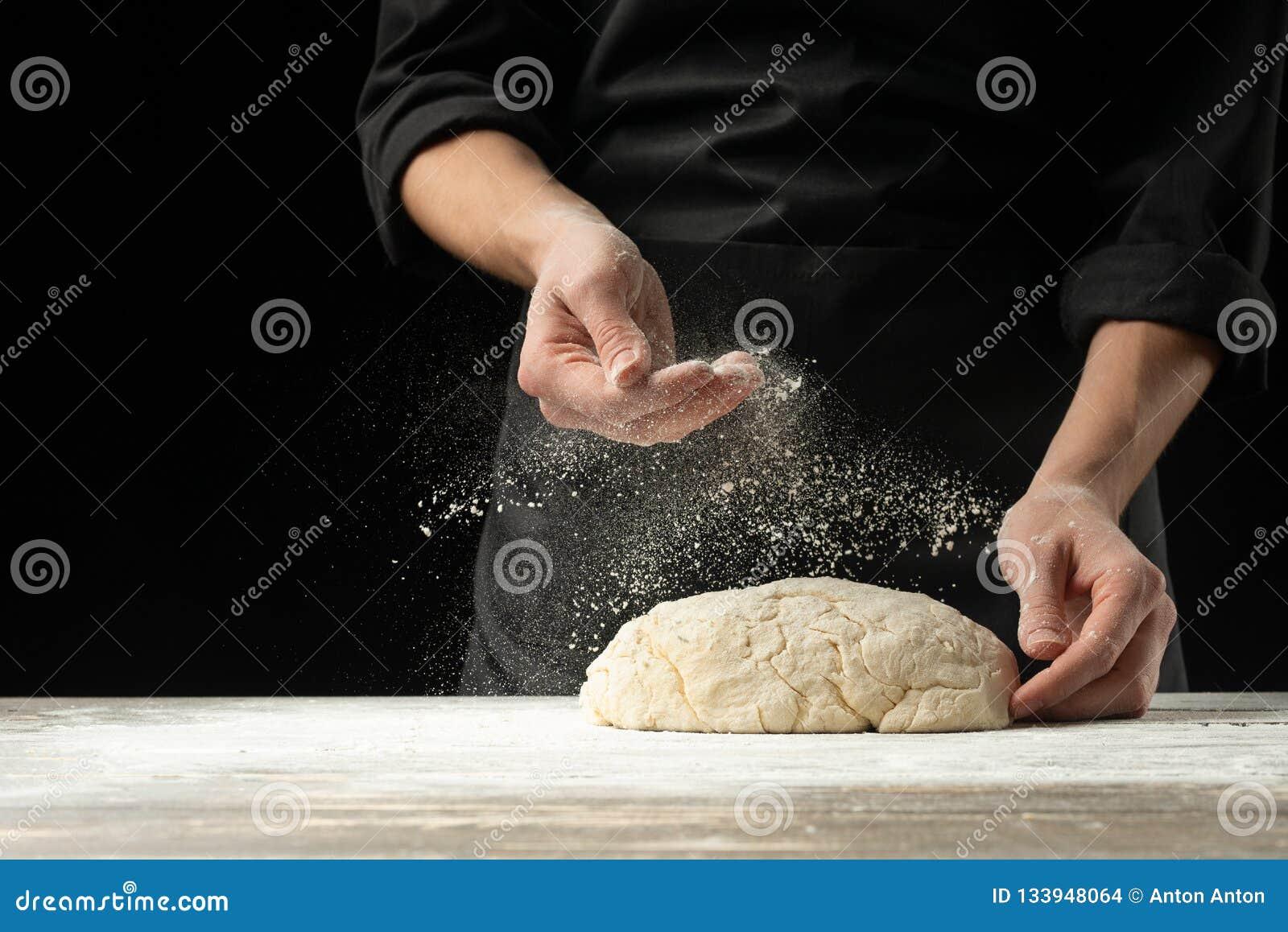 Kucbarski piekarz przygotowywa chleb, focaccia, pizza, babeczki, cukierki linii brzegowej zielonej horyzontalnej wizerunku fotogr