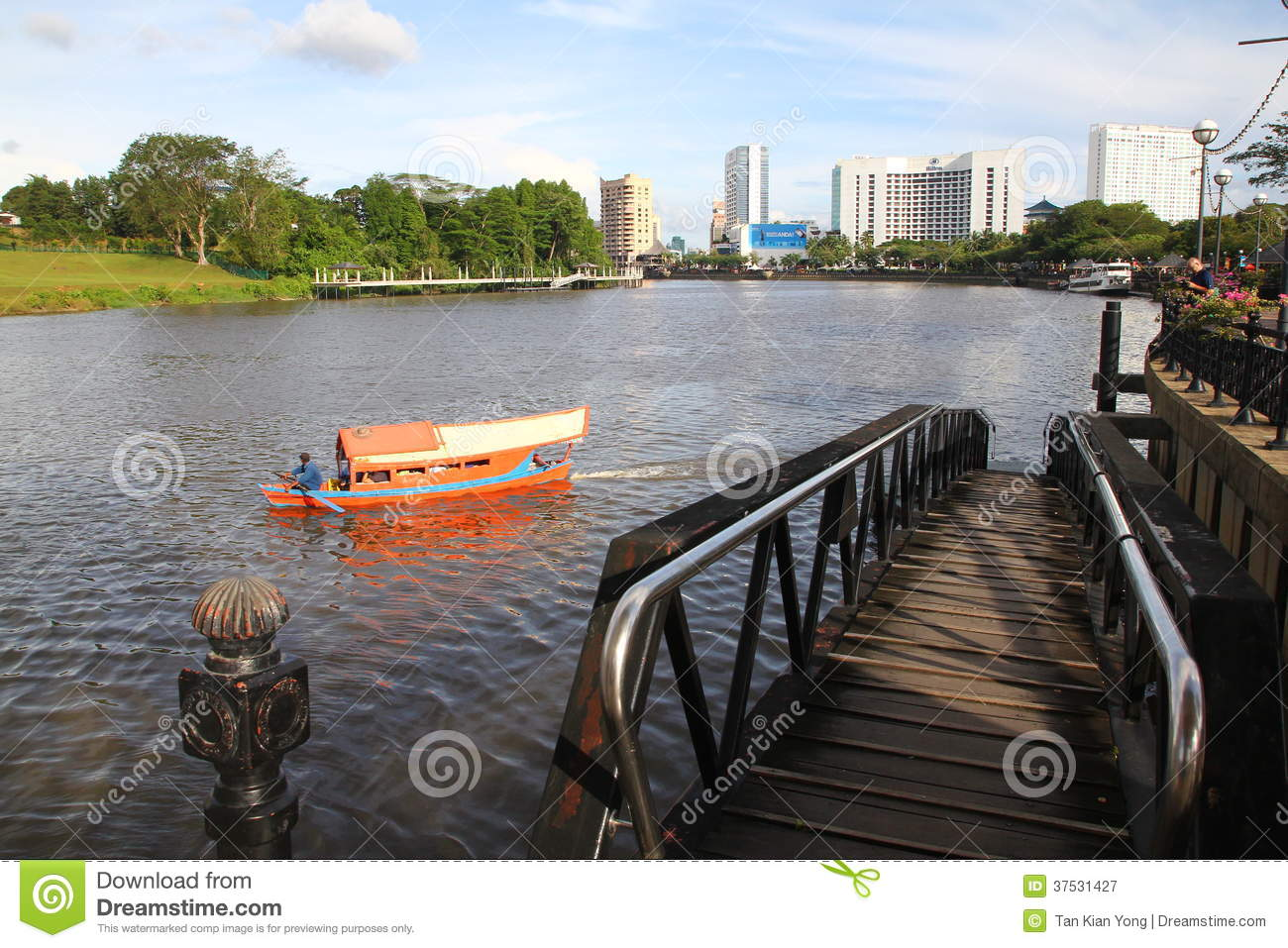 Kuching City Riverside With Traditional Boat Editorial