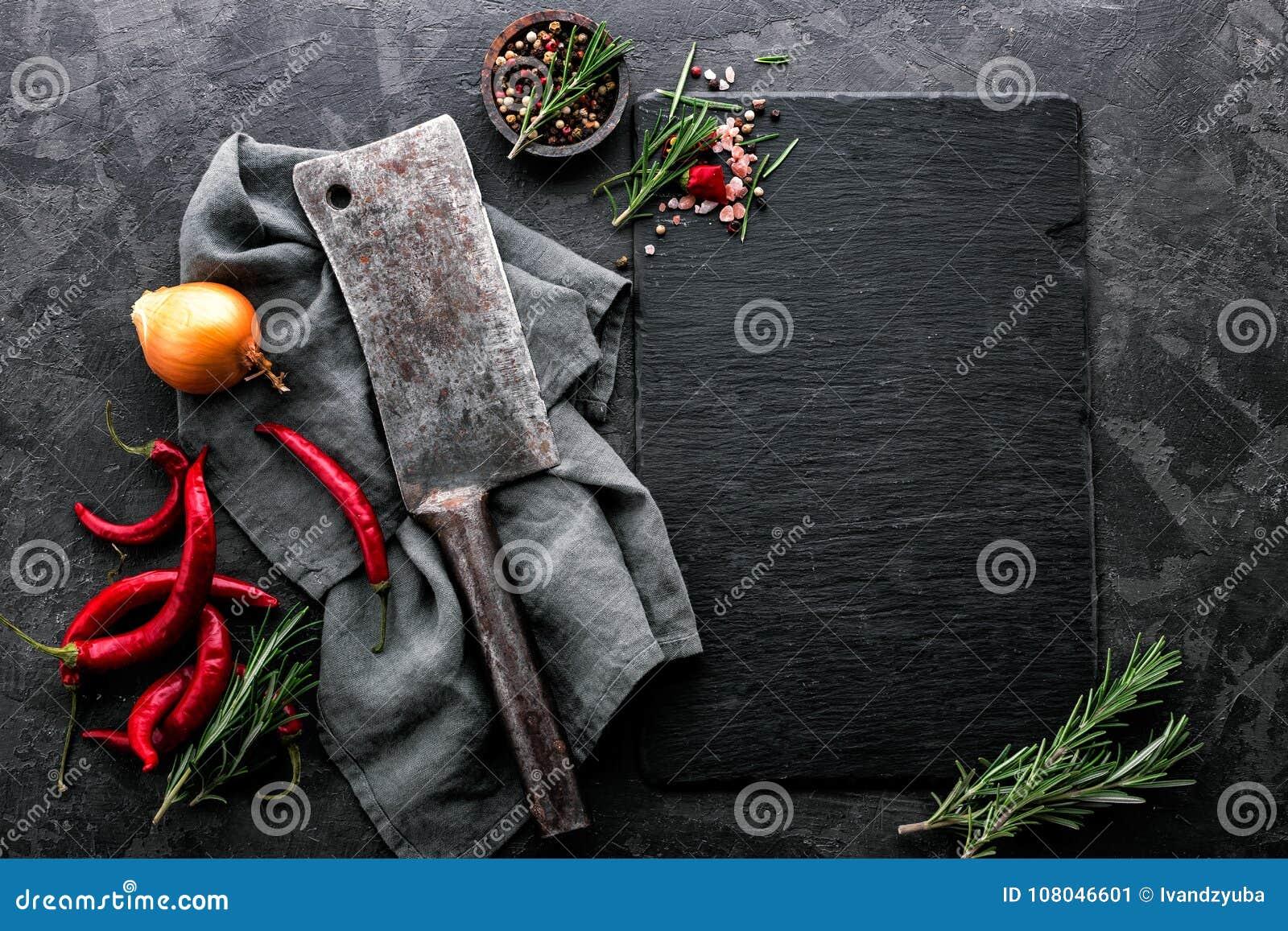 Kulinarny tło z pustą czerń łupku deską