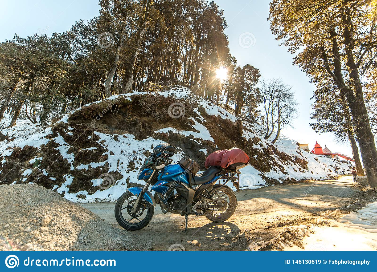 Kullu, Himachal Pradesh, India - November 24, 2019 : Motorcycle ride on winter slippery road in himalayas