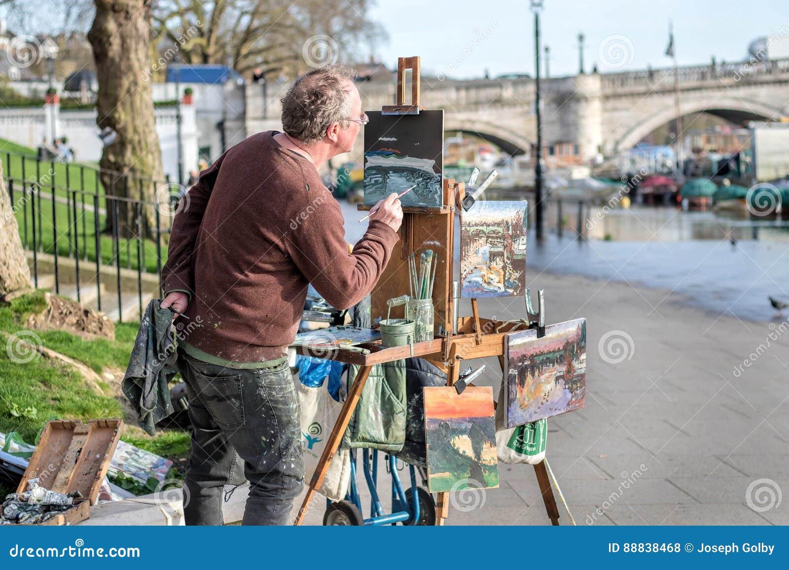 Kunstenaar het schilderen rivierlandschappen
