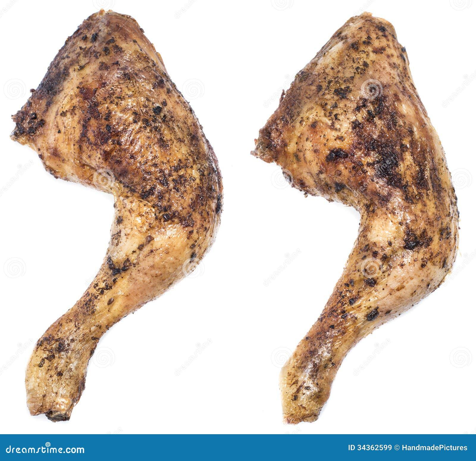 Kurczak nogi odizolowywać na bielu