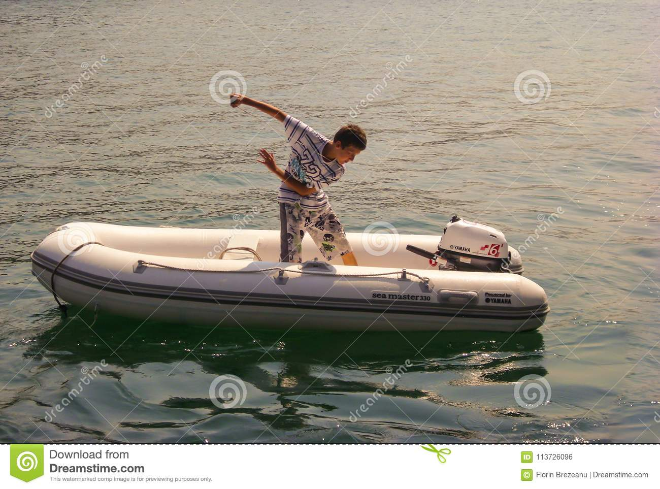Kusadasi, Turkey - June 17 2012 : A Boy Is Starting The Outboard