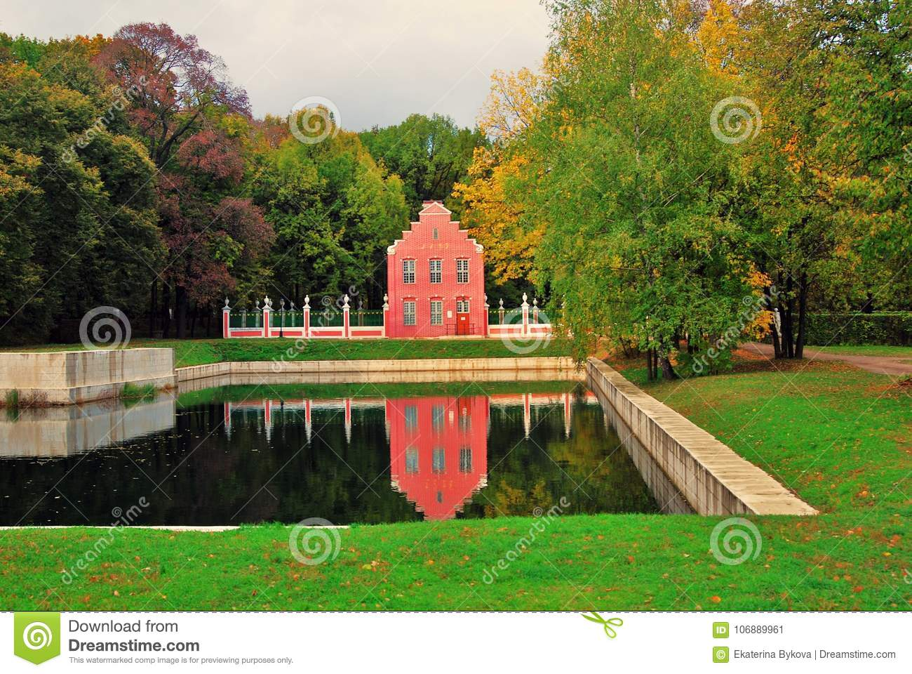 Kuskovo park in Moscow. Dutch house. Autumn nature and pond.