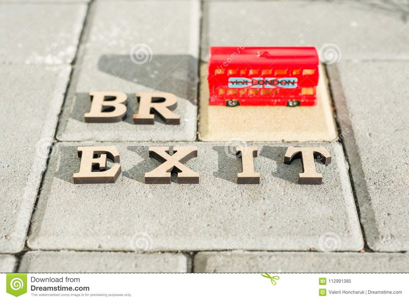 Kyiv, UA, 17.11.2017 Britain exit from European Union, Brexit word abstract in vintage letters,background double decker bus toy mo
