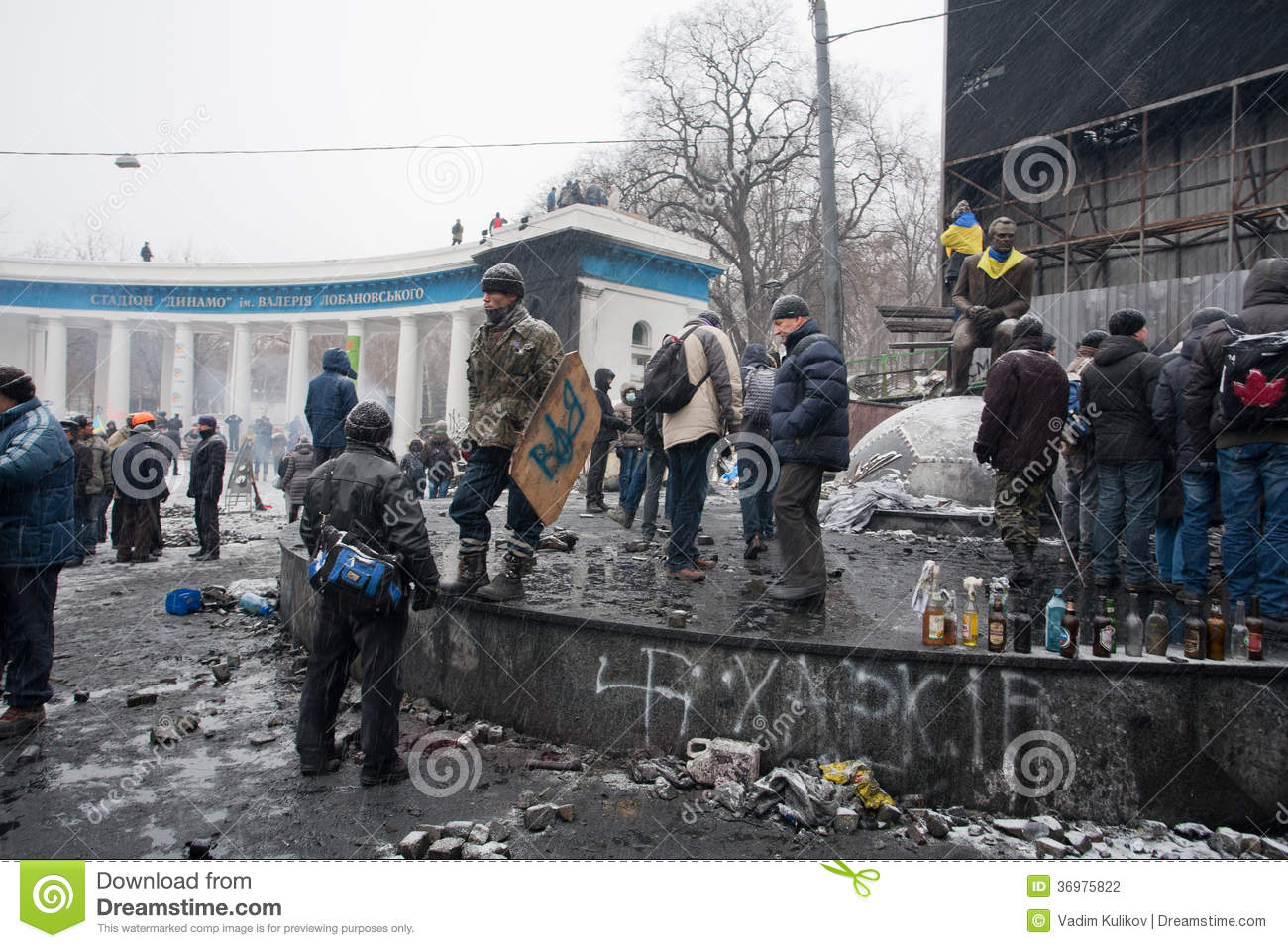 KYIV, UKRAINE: Activists of the riot in uniform wait for the fight with police in the burned square