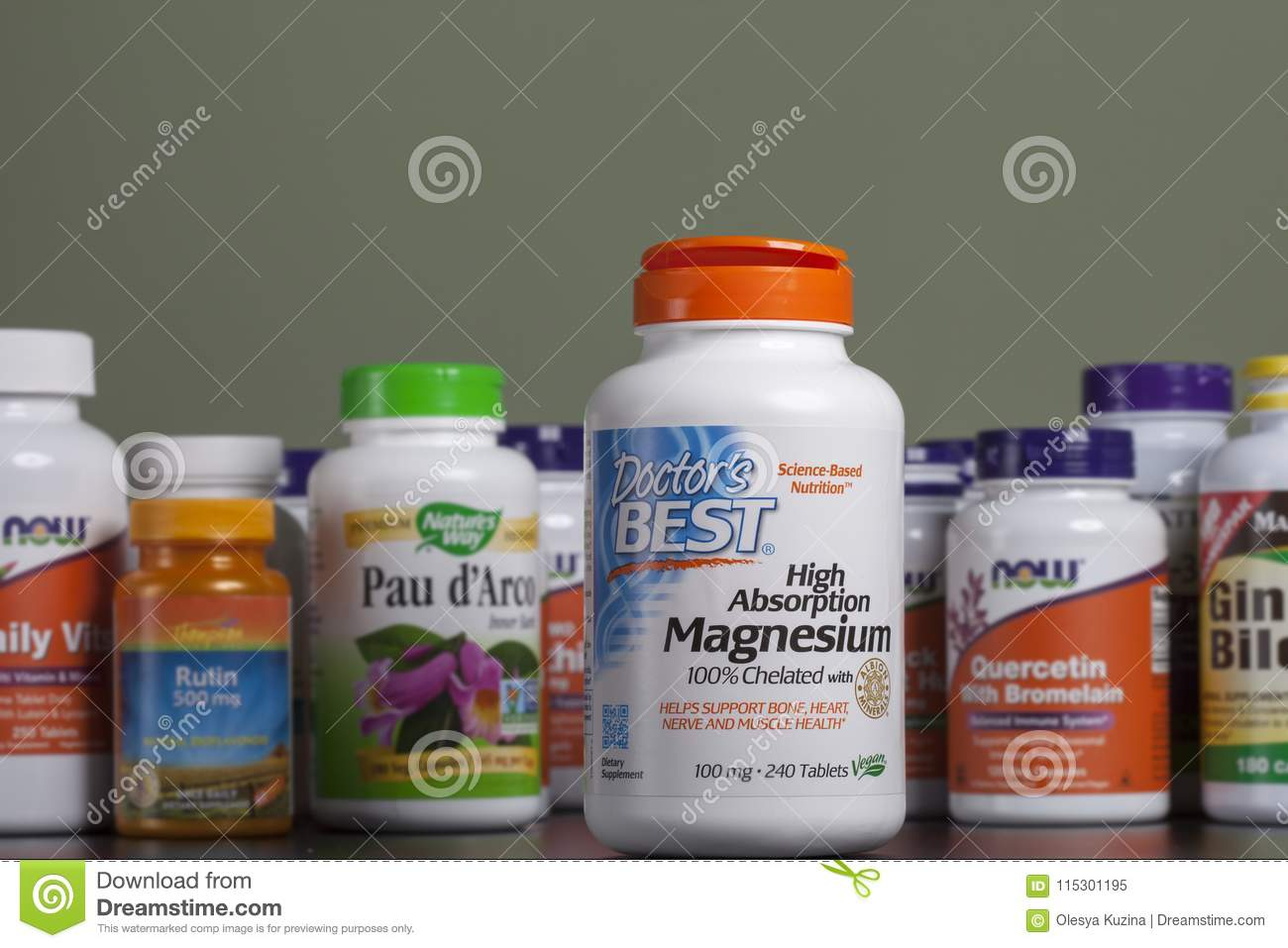 KYIV, UKRAINE - April 24, 2018 A bottle of magnesium in capsules. Some bottles of vitamins and dietary supplements are behind it.