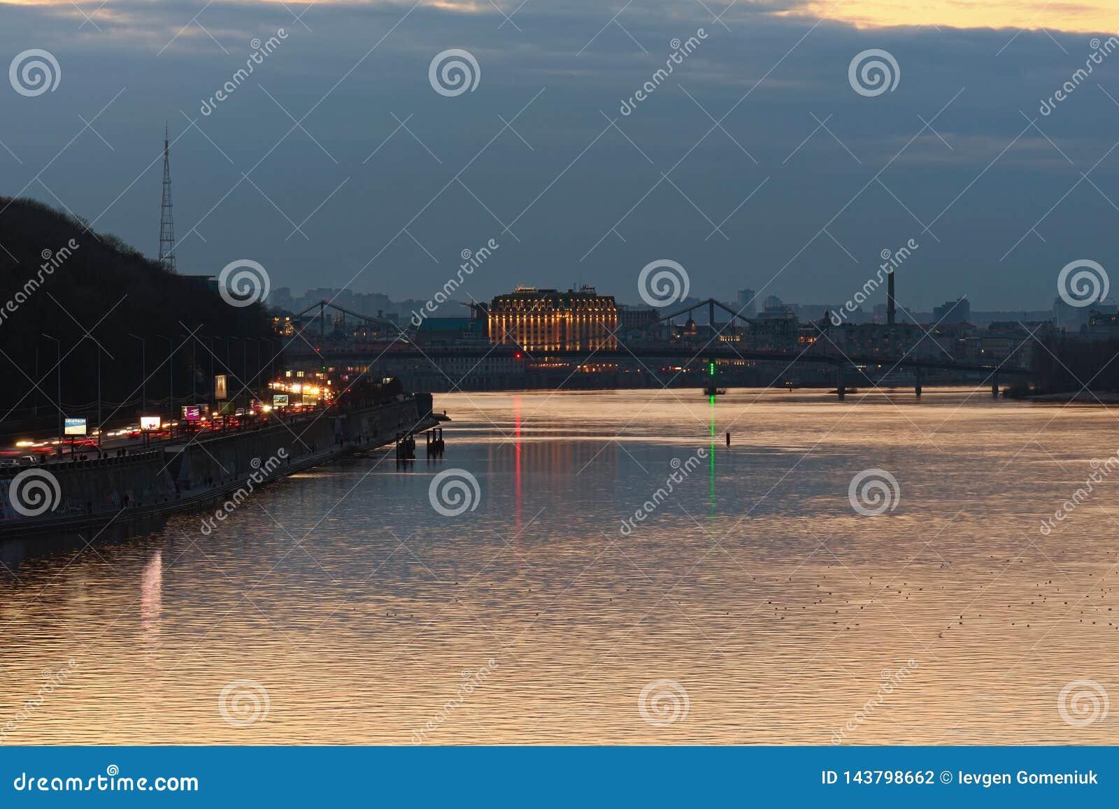 Stunning evening landscape of the Pedestrian bridge over Dnipro River