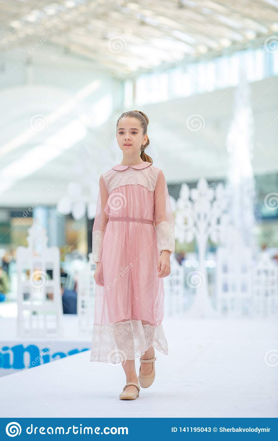 Kyiv, Ukraine March 03.2019. UKFW. Ukrainian Kids Fashion Day. Little girl wearing at pastel dress