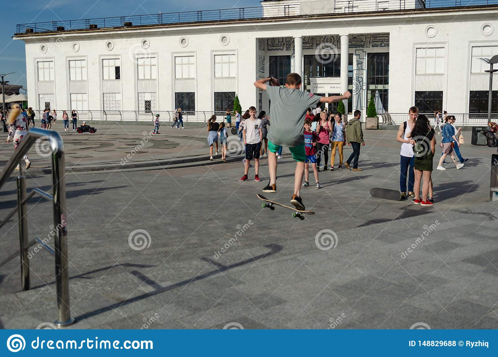 Kyiv, Ukraine - May 18, 2019. Poshtova square. Teen skateboarder practicing tricks