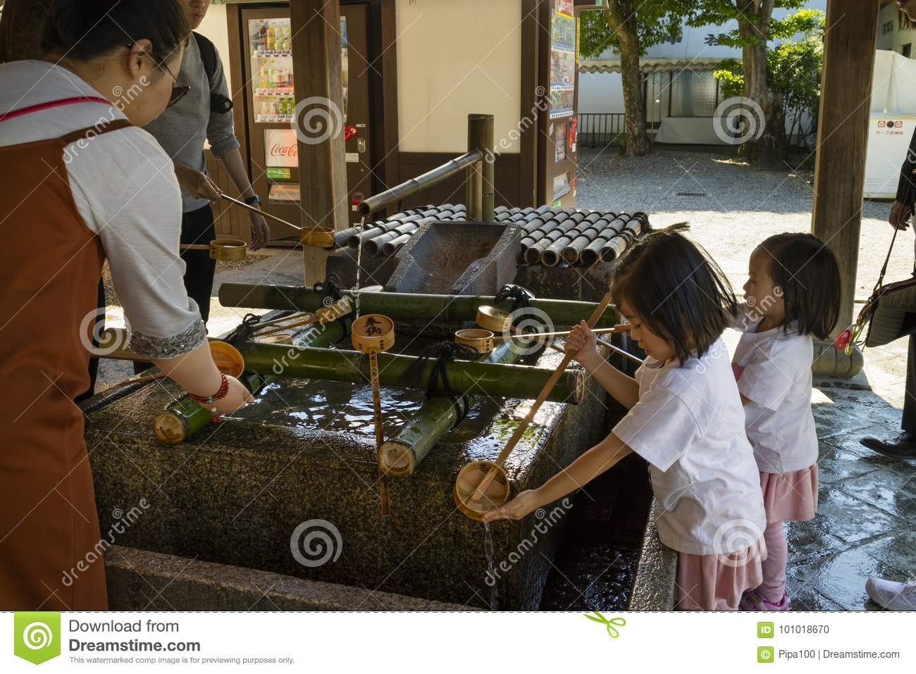 Kyoto, Japan - May 18, 2017: Children cleaning their hands at a