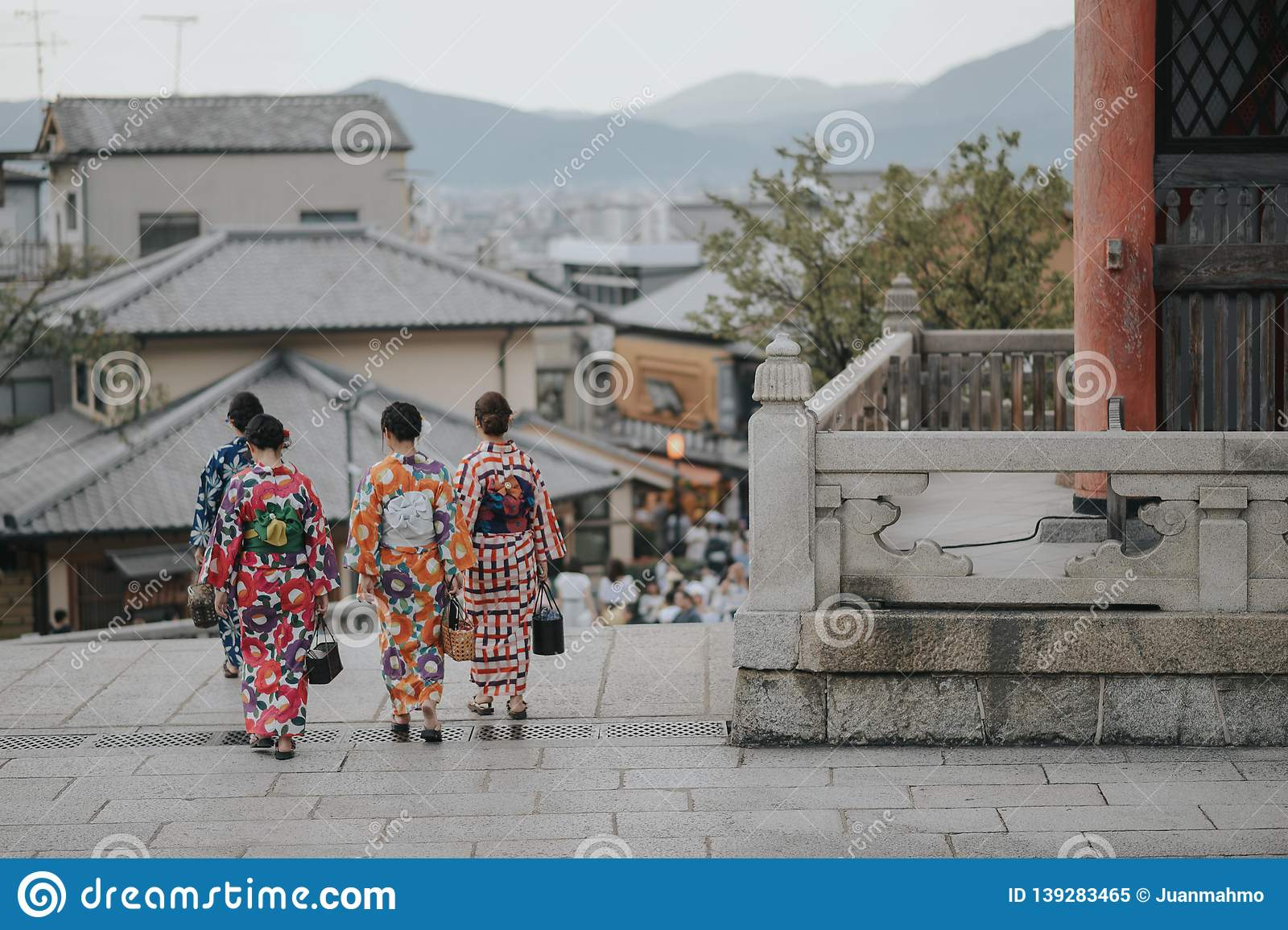 KYOTO, JAPAN, SEPTEMBER 14, 2017: group of young asian women wearing a traditional kimono dress