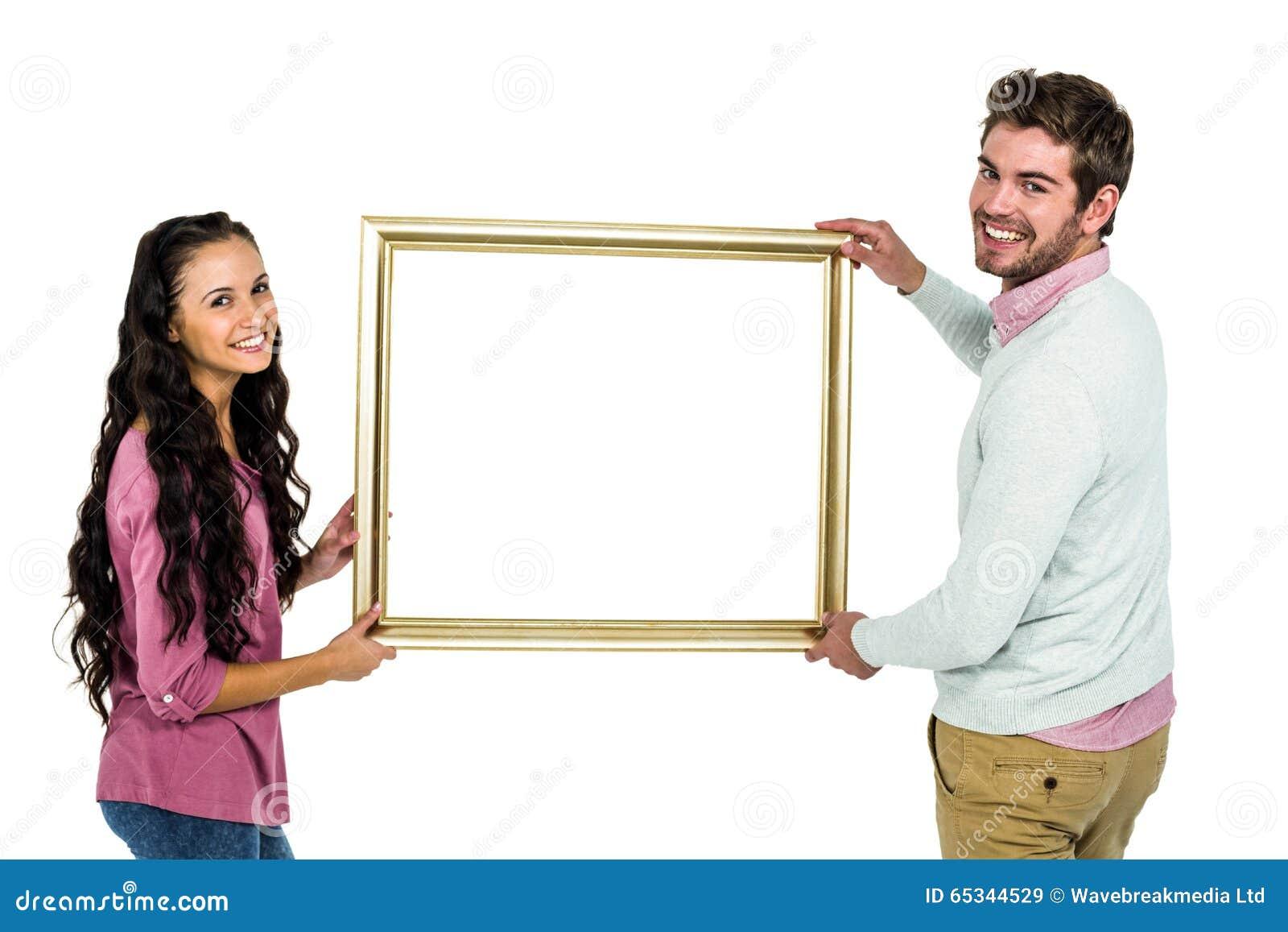 Lächelnde Paare, Die Bilderrahmen Halten Stockbild - Bild von ...