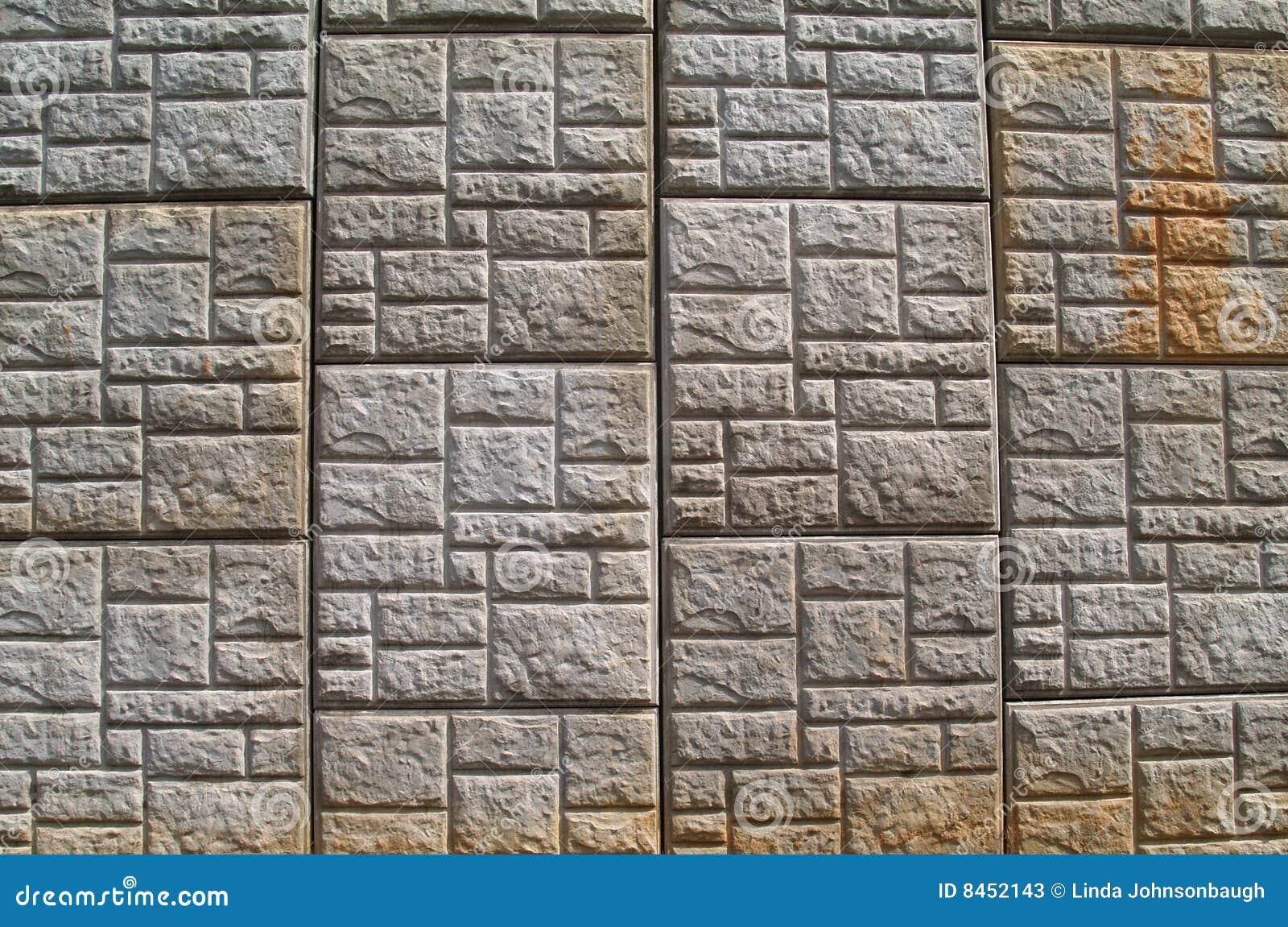 Längs den konkreta huvudvägen mönstrad behållande vägg