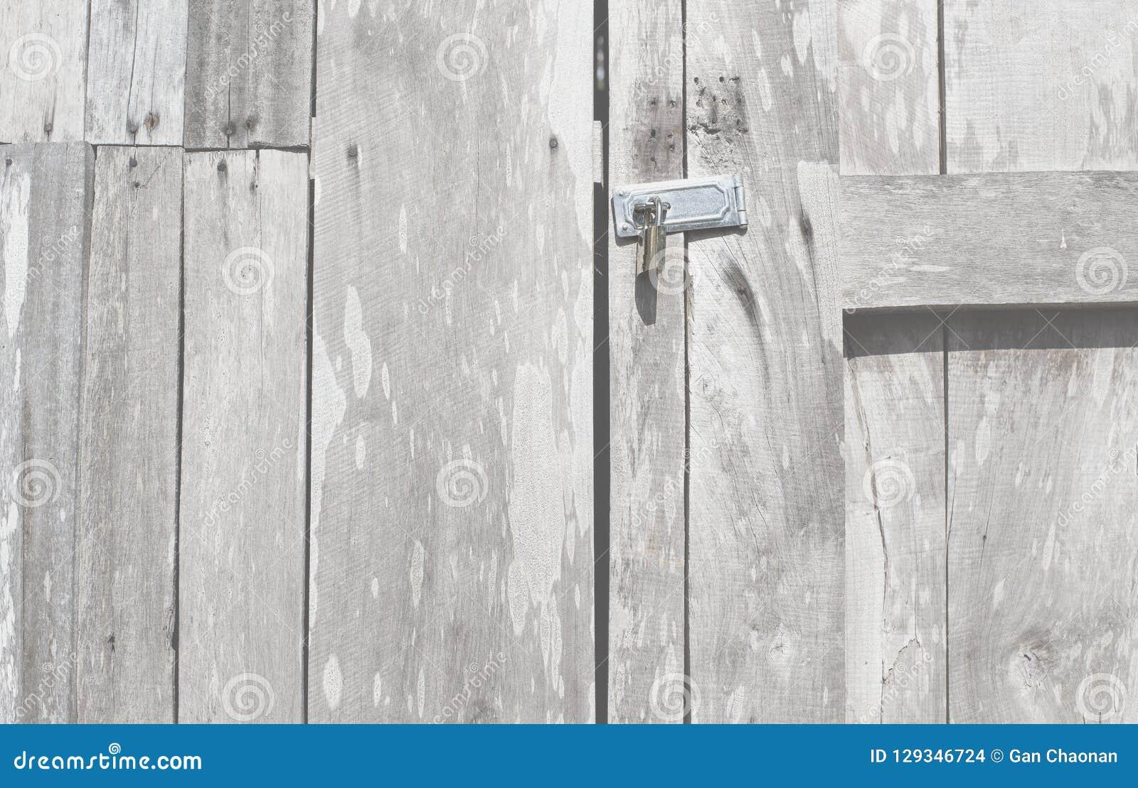 Låsa stilen för dörren för dörren den retro träthai gamla och för antikvitetlåsdörren Bakgrundscloseupträdörr med låset