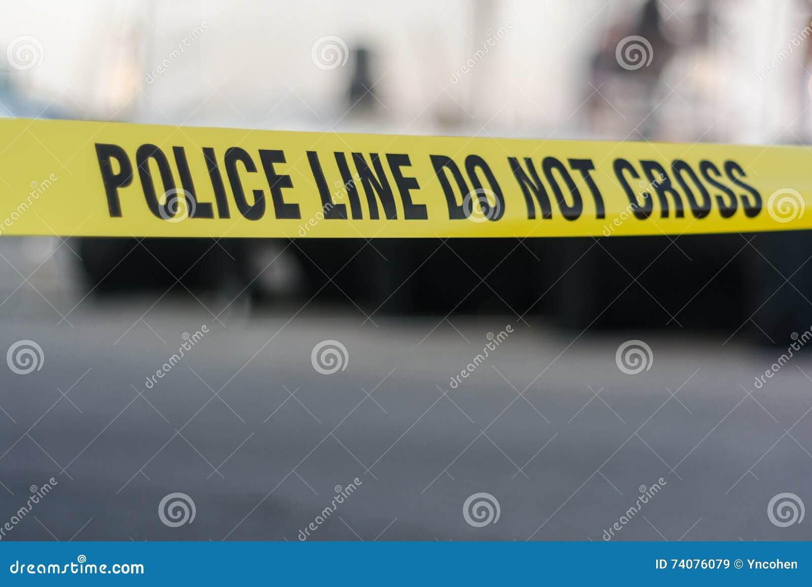 Línea de policía amarilla cinta