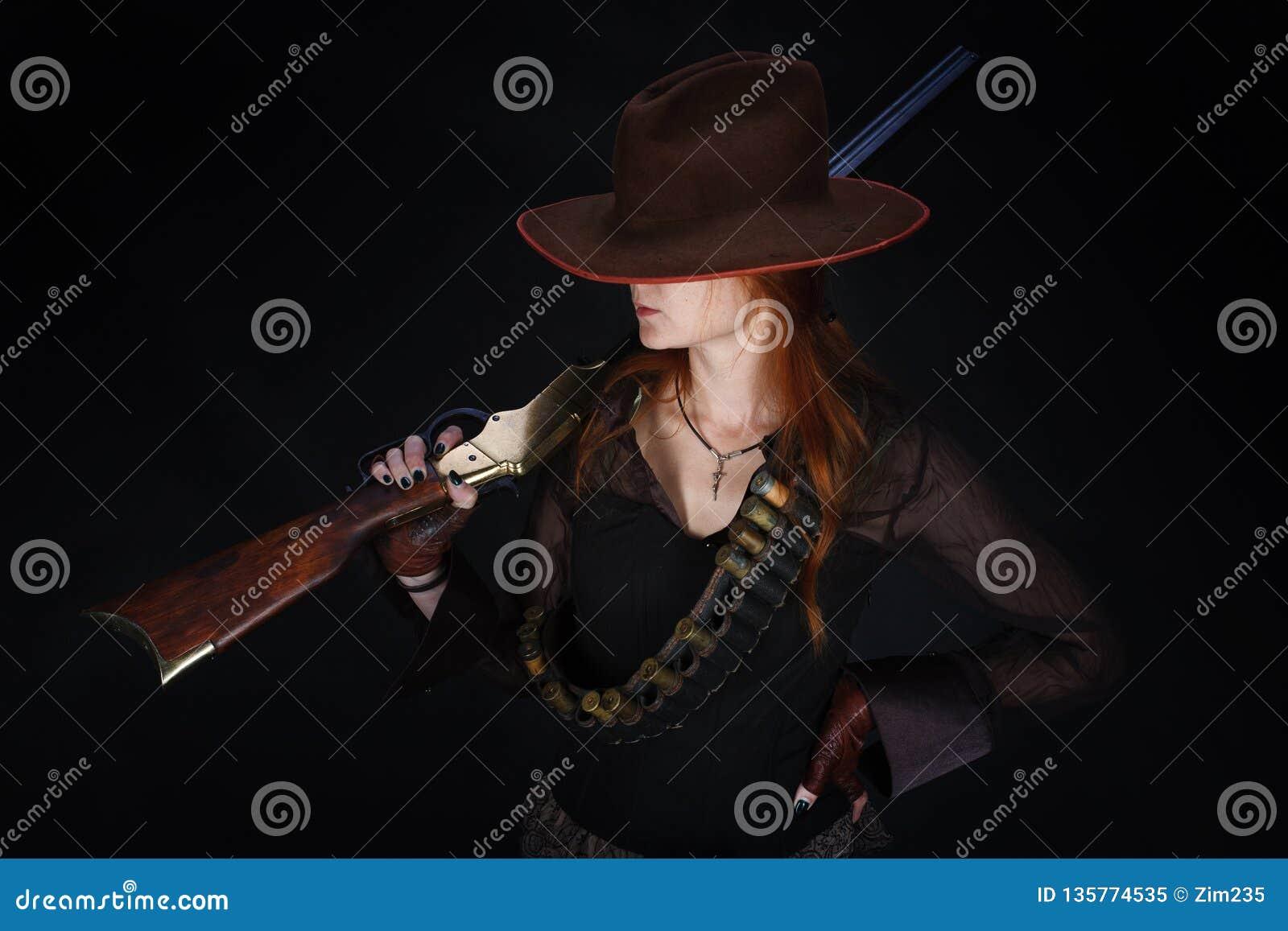 Lös västra flicka med geväret