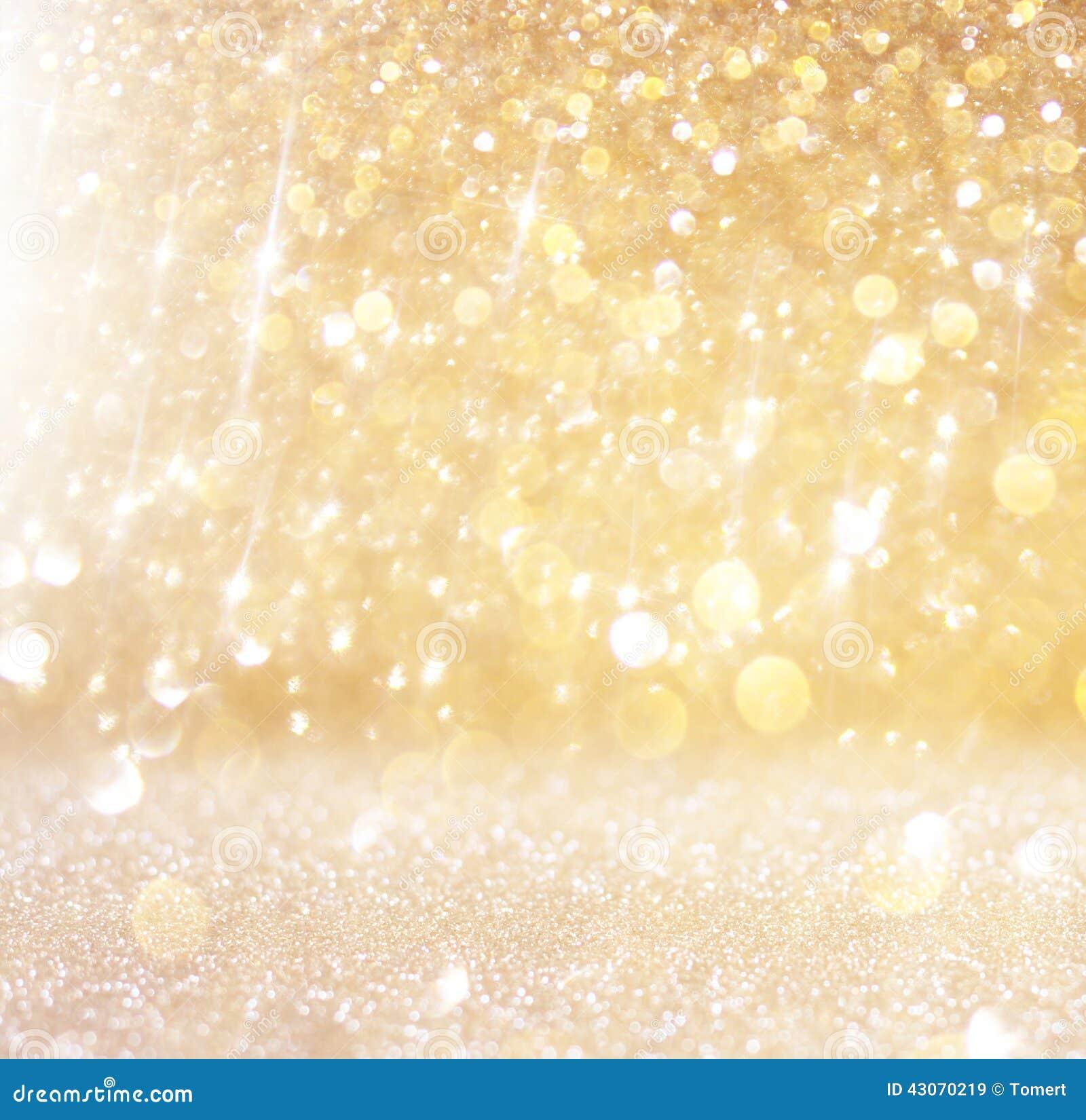 L annata di scintillio accende il fondo oro leggero ed il nero defocused