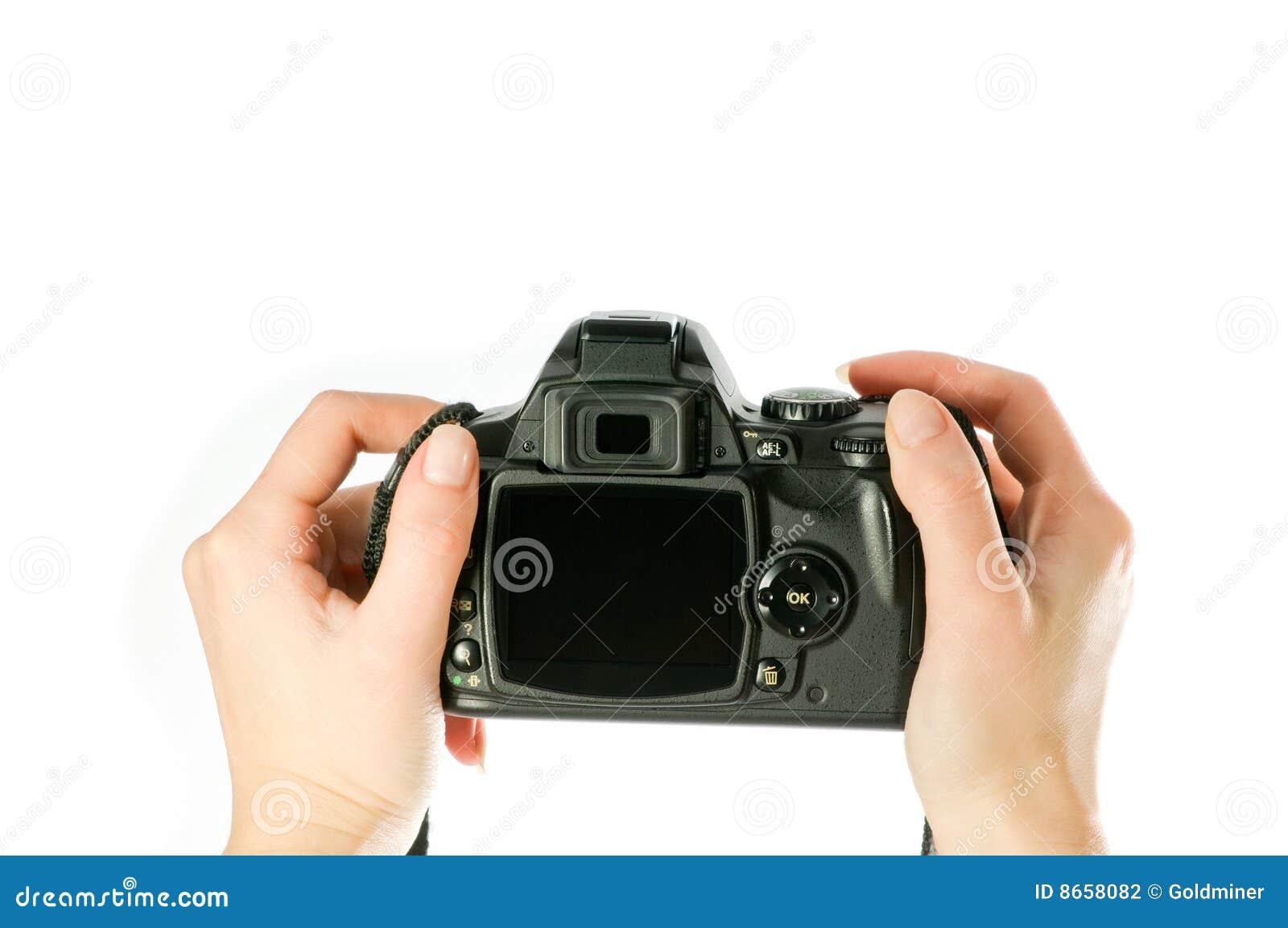 L appareil-photo remet la femme