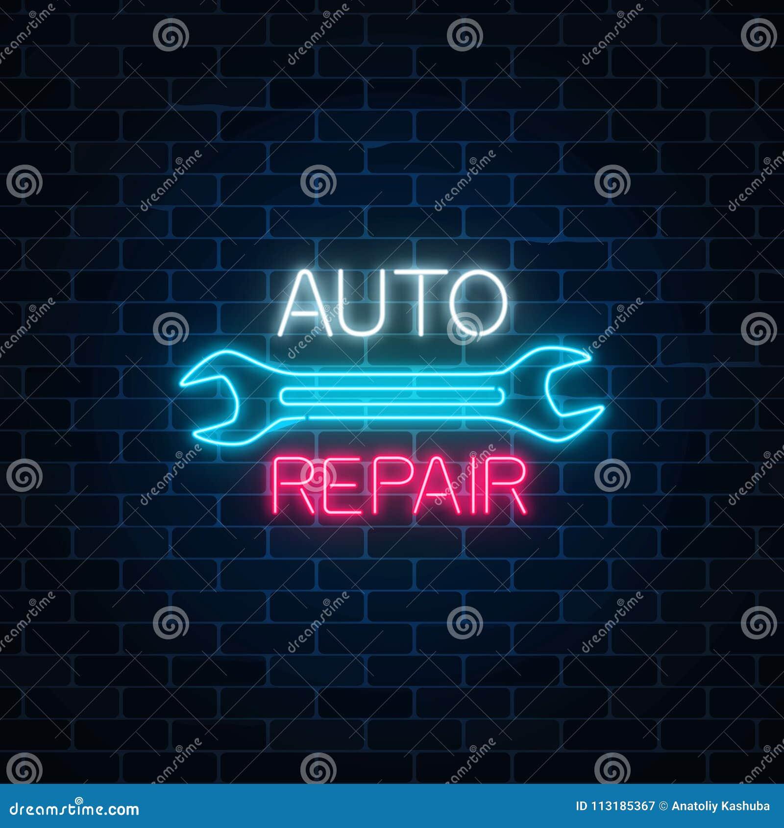 L atelier de réparations automatiques au néon se connectent le fond foncé de mur de briques Symbole rougeoyant de la publicité de