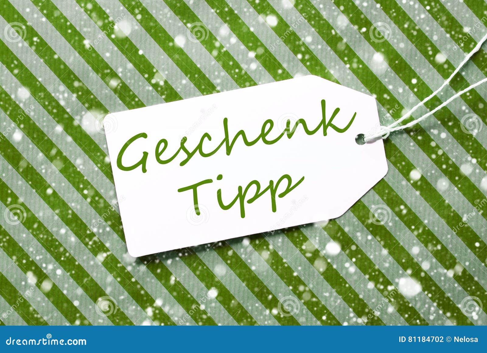 L etichetta, carta da imballaggio verde, Geschenk Tipp significa la punta del regalo, fiocchi di neve
