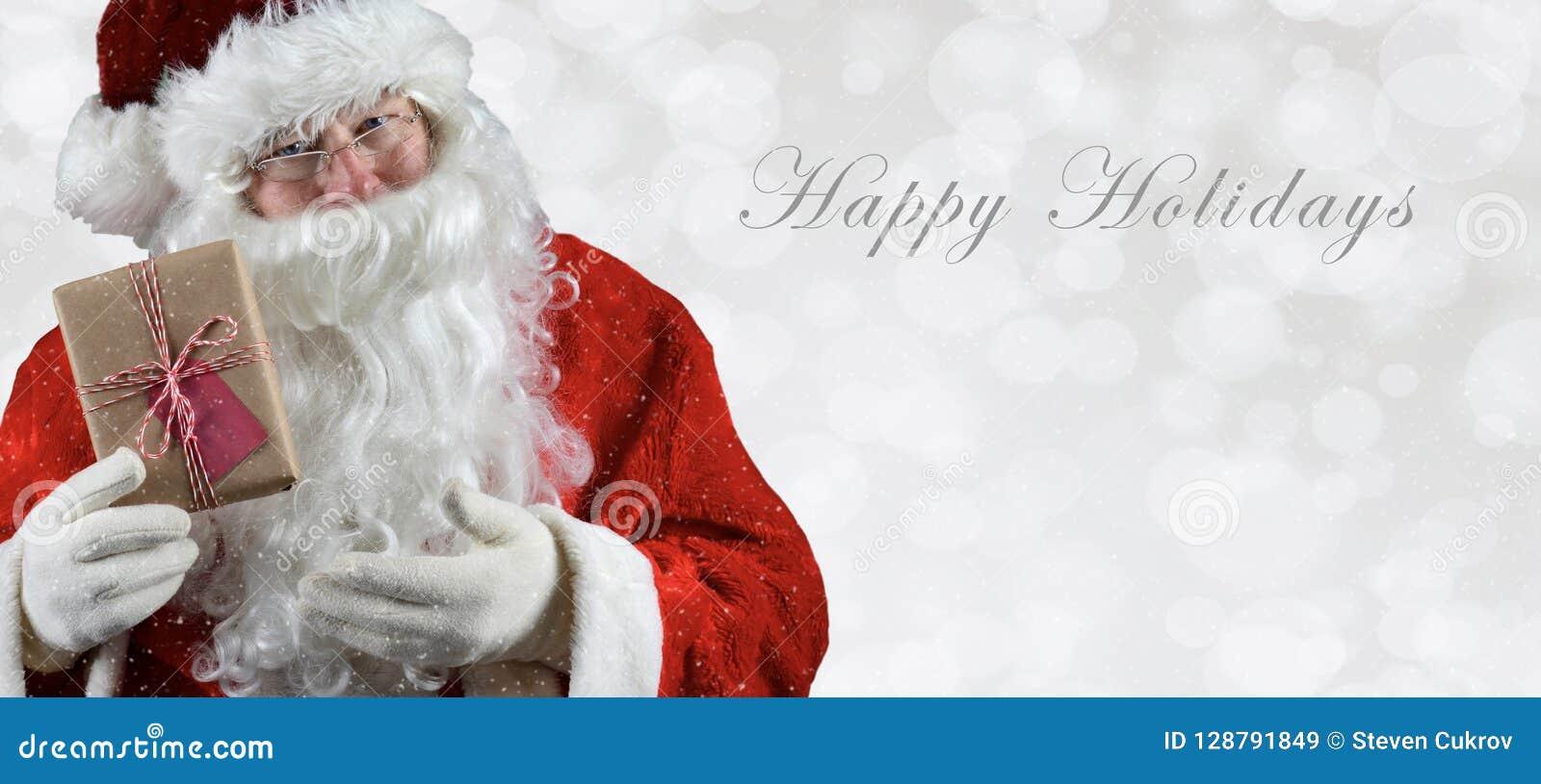 L insegna ha graduato il inage secondo la misura con Santa Claus che tiene un presente
