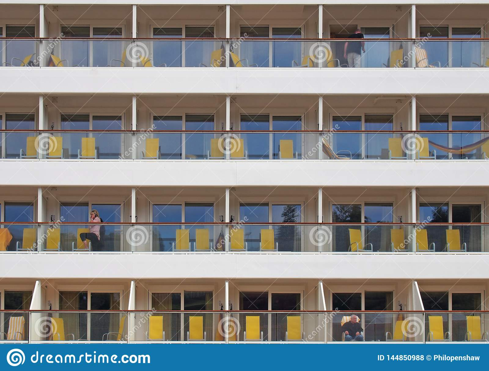 l, madeira, portugal - 13 march 2019: close up of a cruise ship moored in funchal harbor showing cabins with sun loungers and