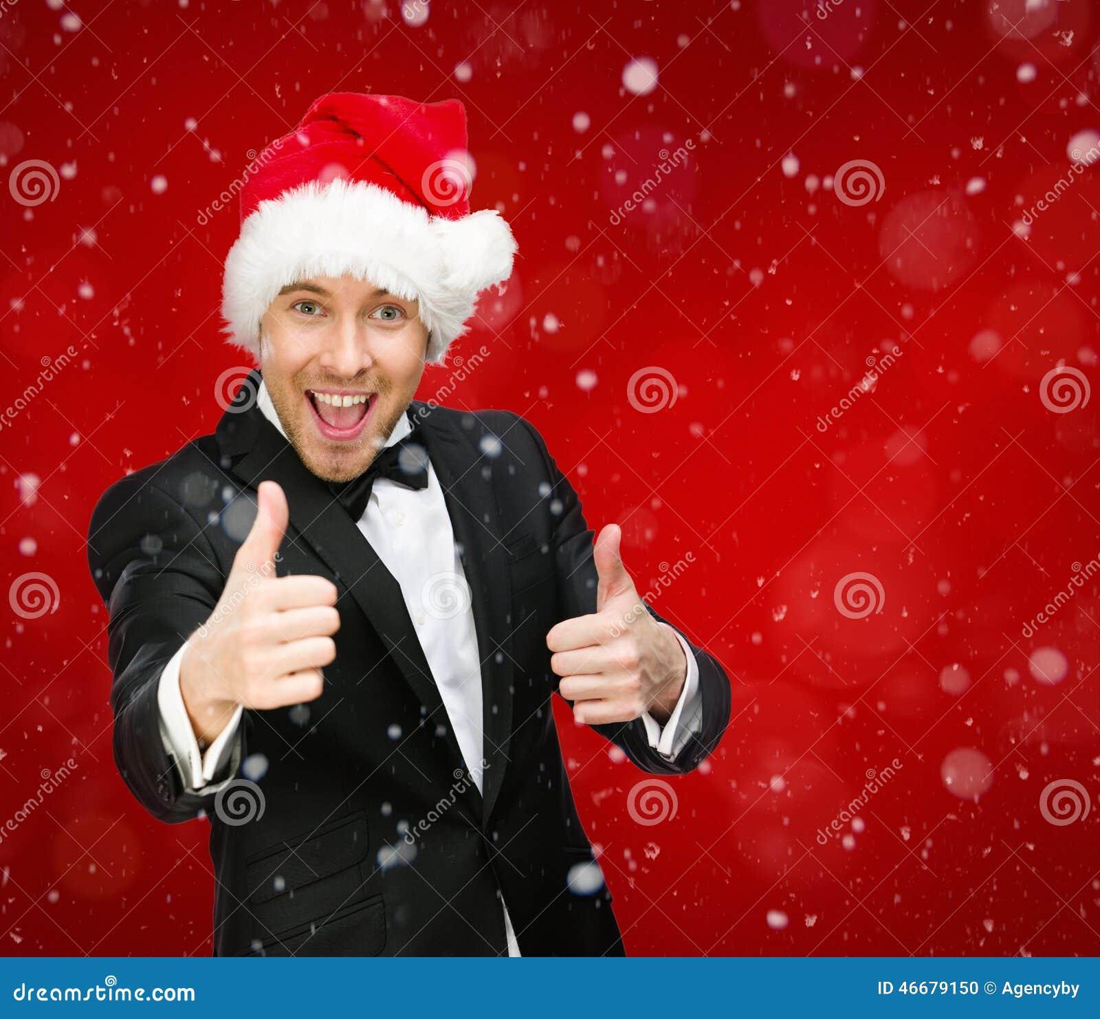 L uomo d affari che indossa il cappuccio di Santa Claus sfoglia su