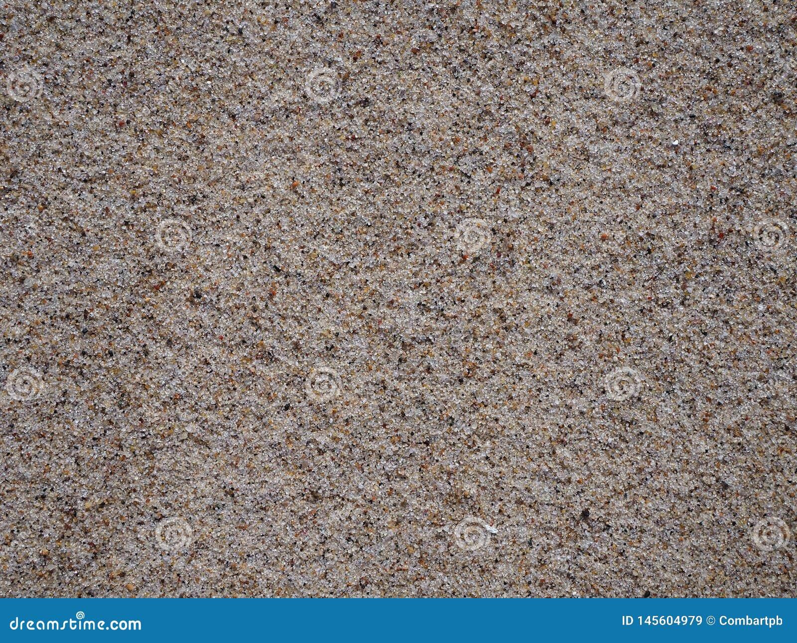 La arena y la playa, perfeccionan para un fondo o un papel pintado