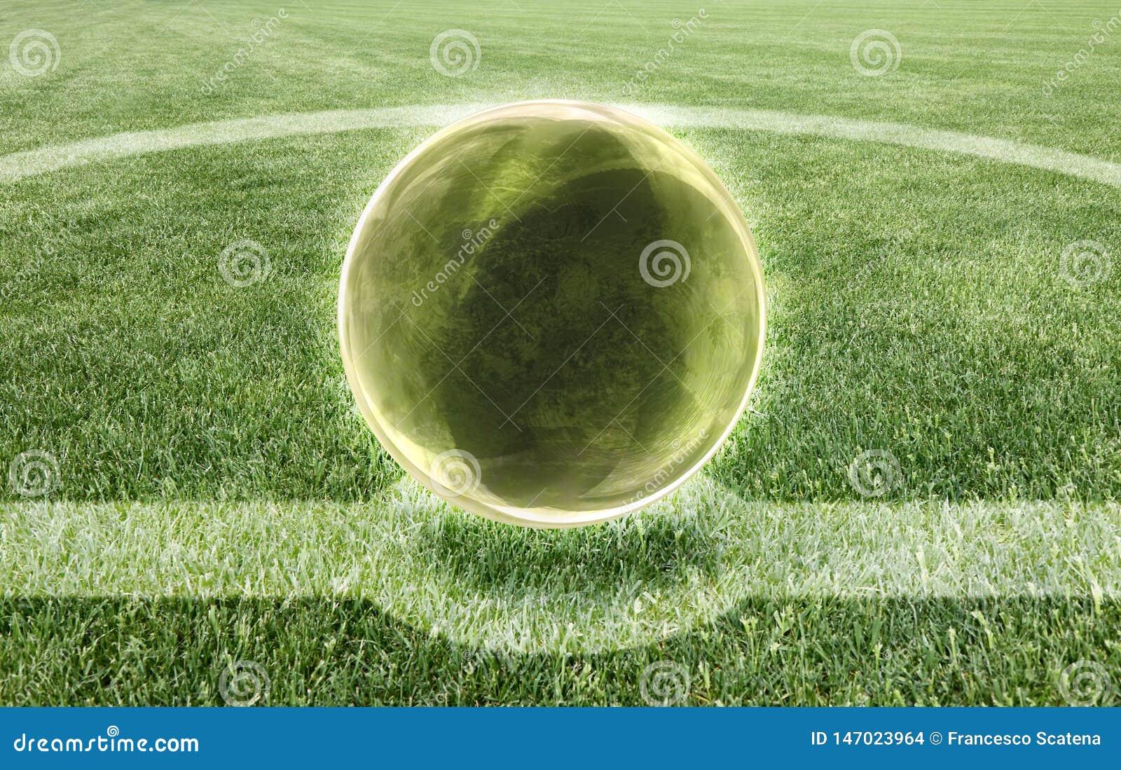 La bola de cristal en el medio de un campo de fútbol - predicción de la imagen del concepto del resultado