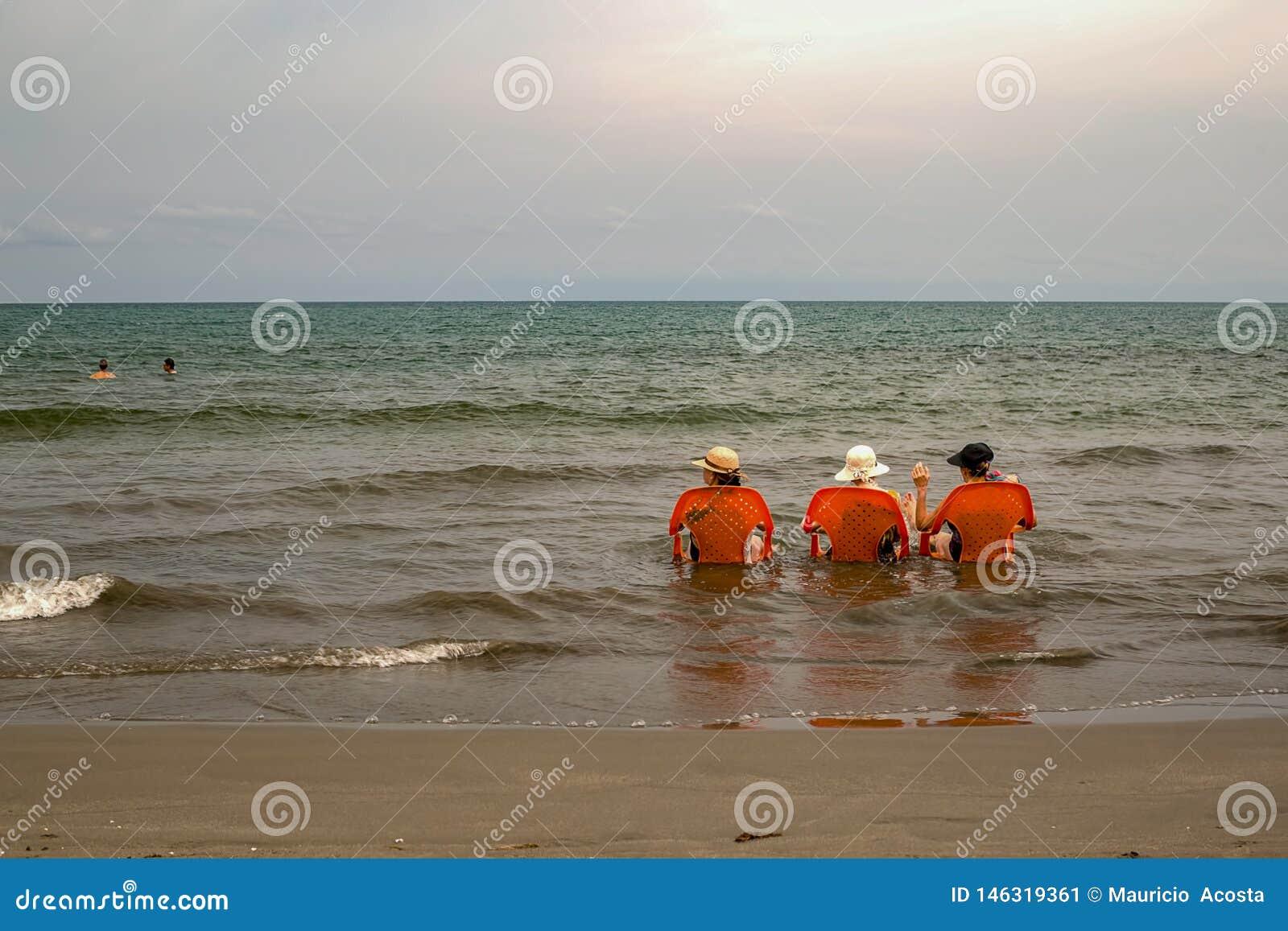 Three old ladies sea bathing in the Caribbean