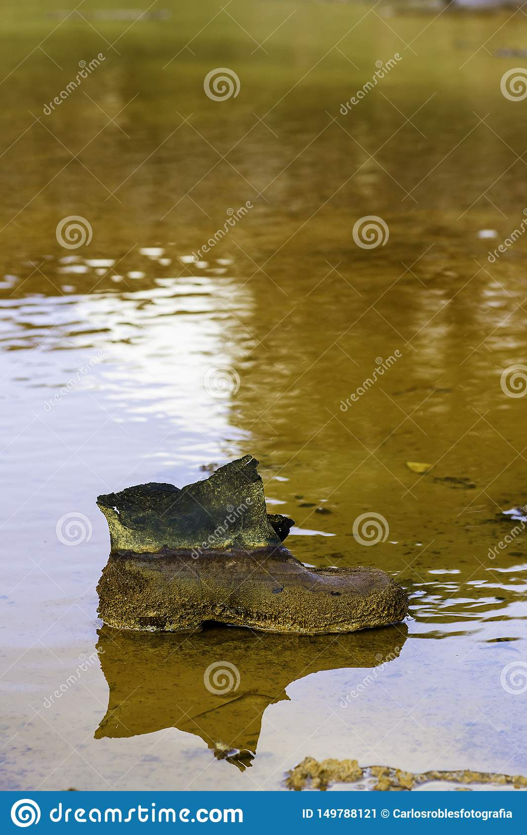 La botte du mineur avec le rouge de patine de rouille