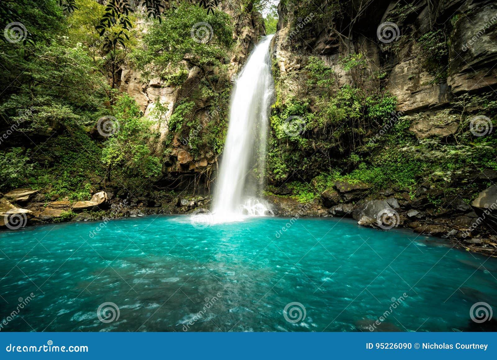 `La Cangreja` Waterfall, Costa Rica. A beautiful pristine waterfall in the rainforest jungles of Costa Rica